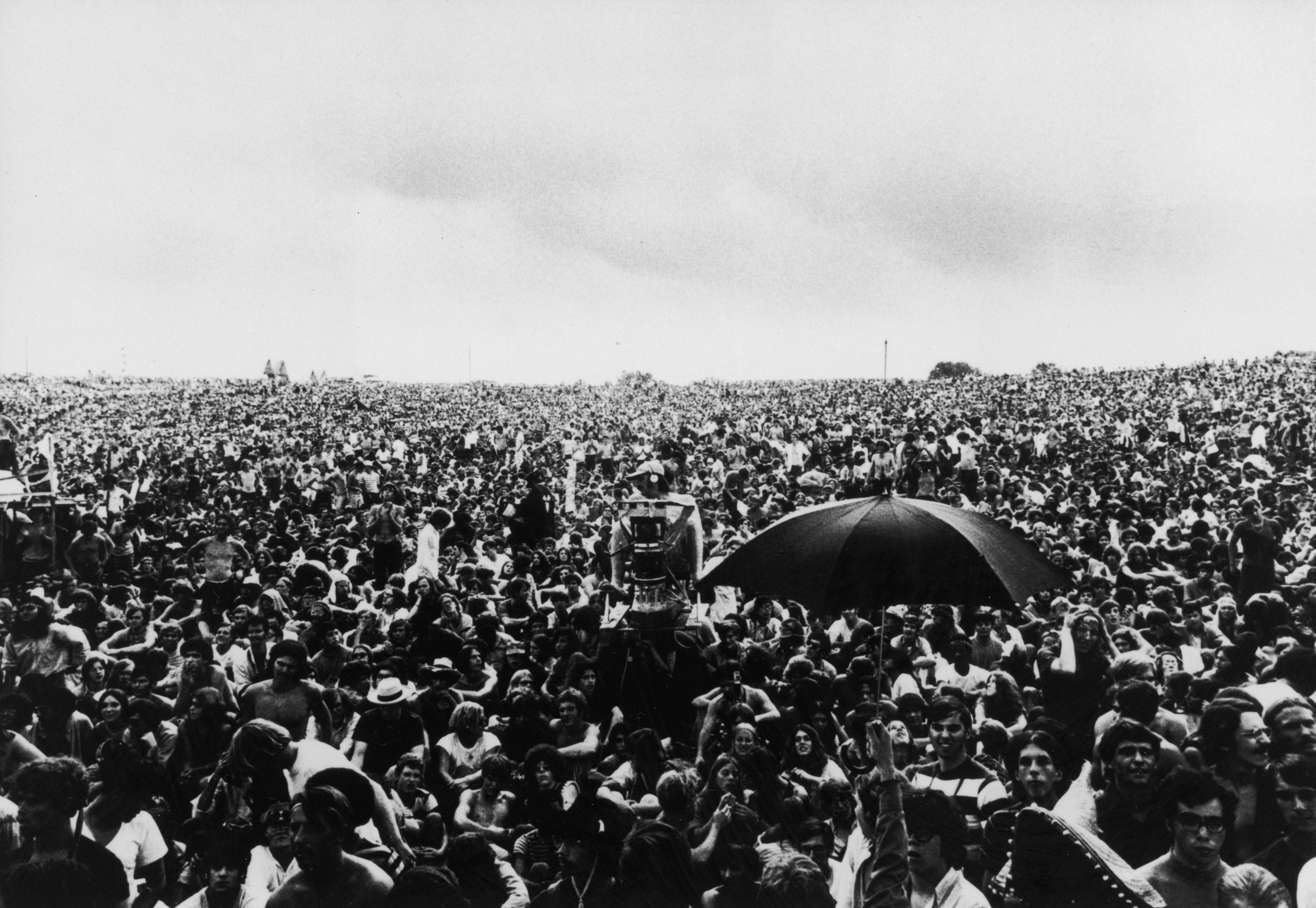 View of the massive crowds at the Woodstock music festival in 1969