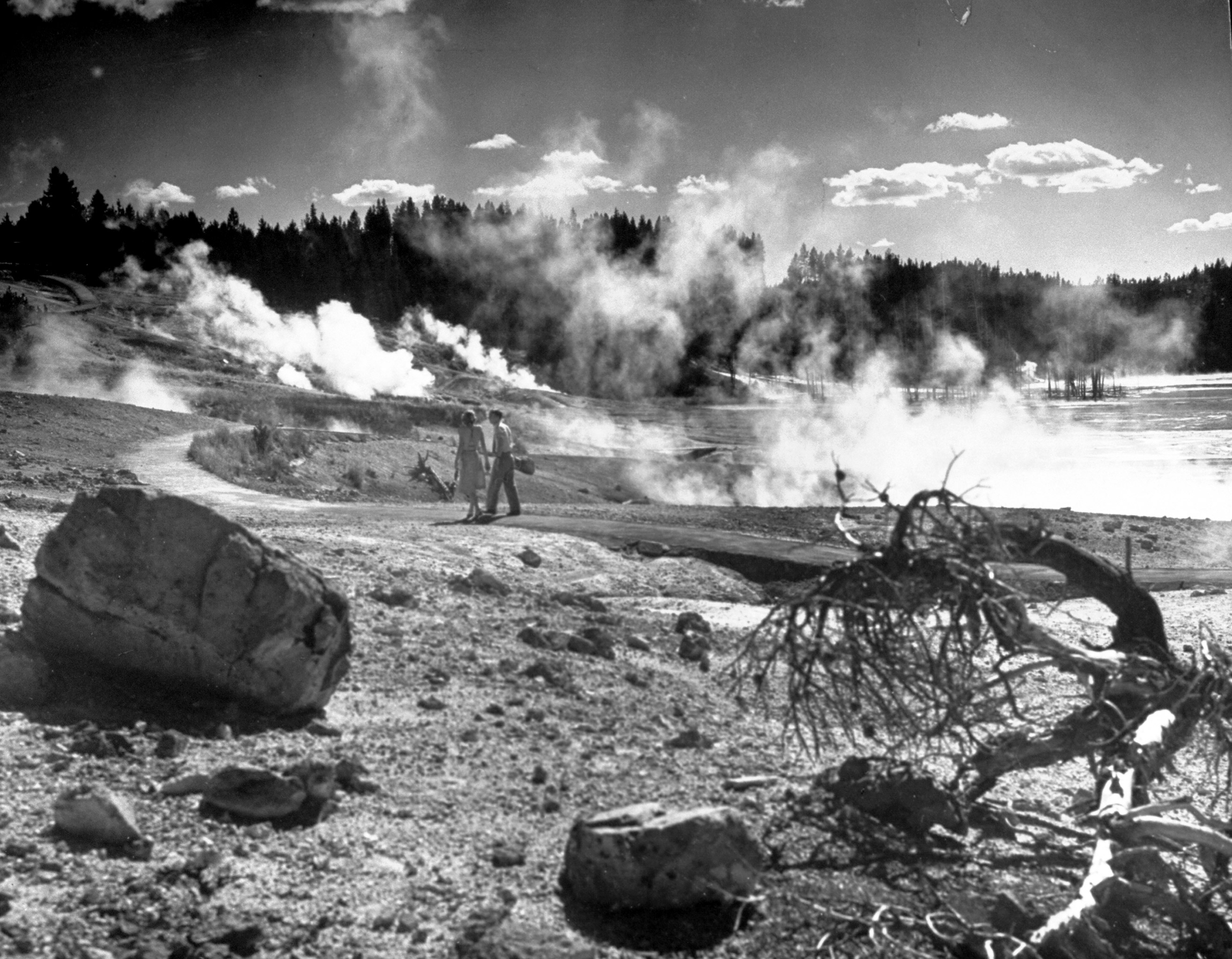Caption from LIFE. Norris Geyser Basin is a bowl-like area containing 30 geysers, most of which erupt every few seconds or minutes, so that there are always several in action.