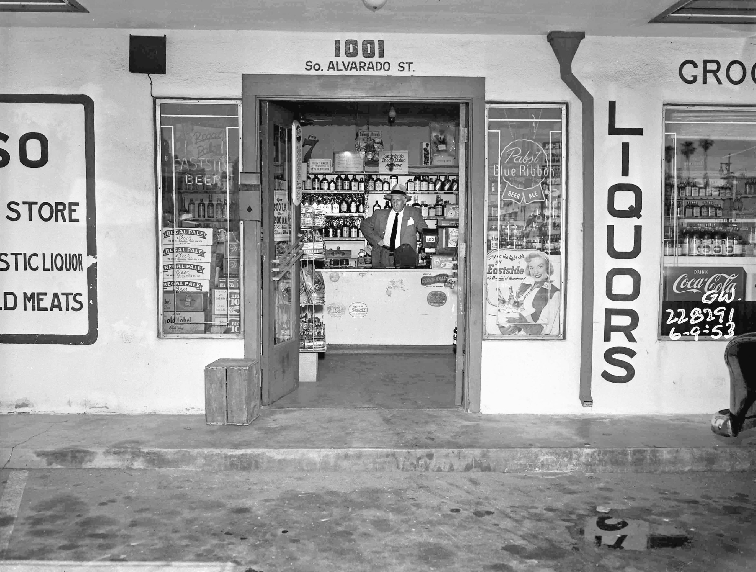 Sgt. Harry Hansen, who worked the Black Dahlia case, stands inside liquor store after a robbery/homicide on June 9, 1953.