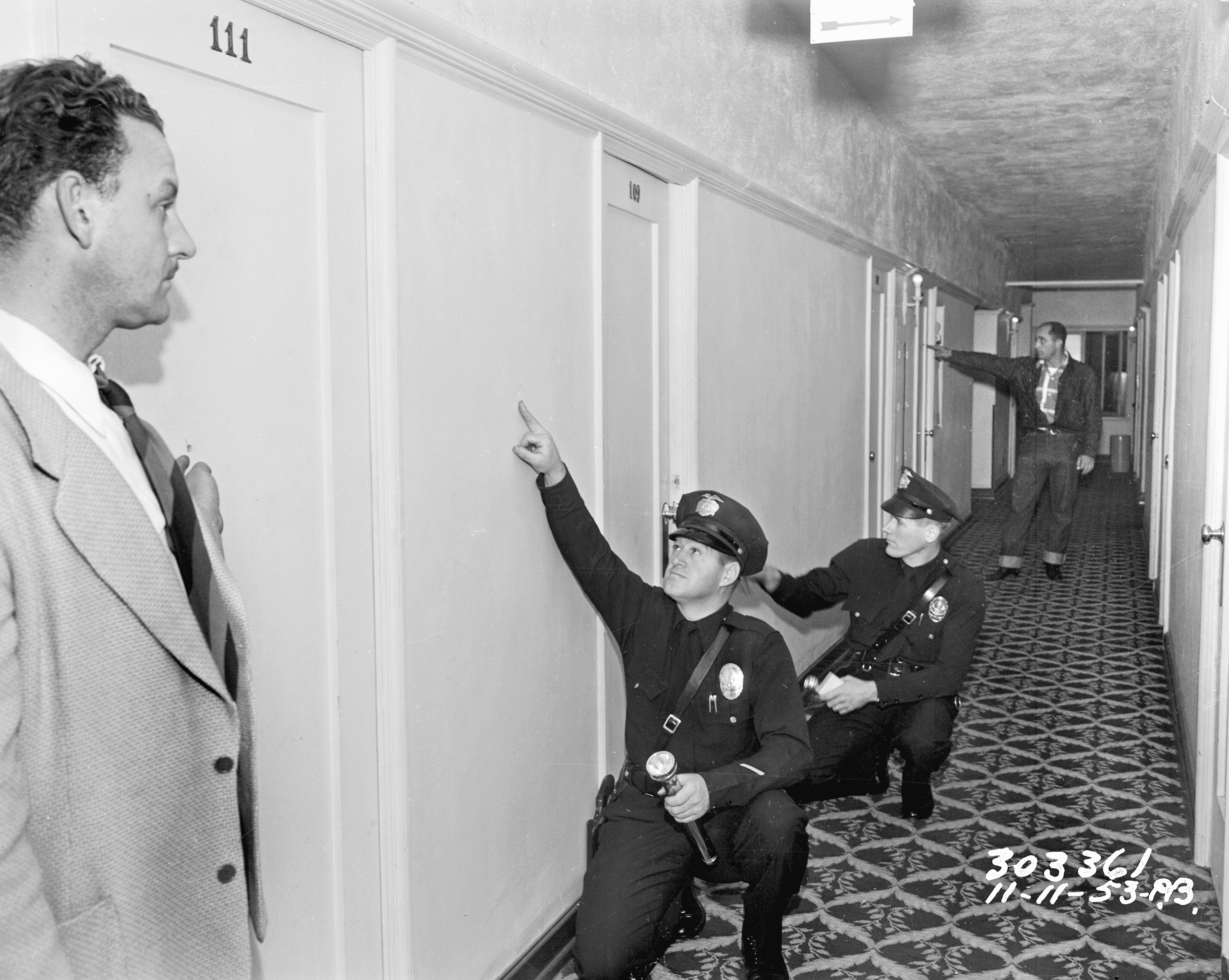 Bad boys in Tinseltown go on shooting spree in apartment building on November 11, 1953.