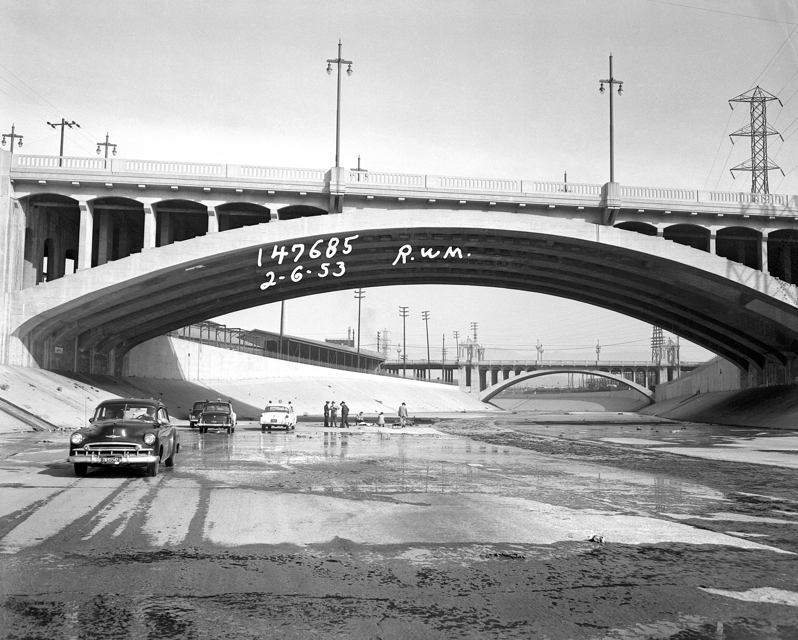 Transient falls 50-feet off Aliso Street Bridge onto the hard concrete of the dry L.A. River bed on February 6, 1953