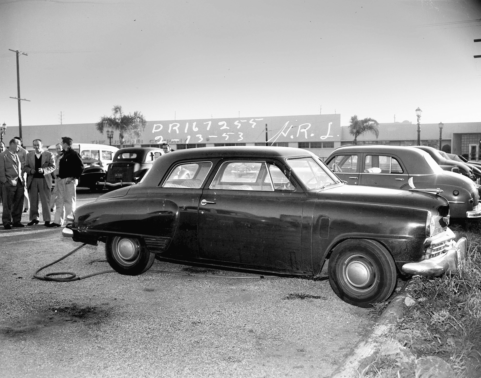 Dead body found in parked car with the motor still running early one February morning on Friday the 13, 1953.