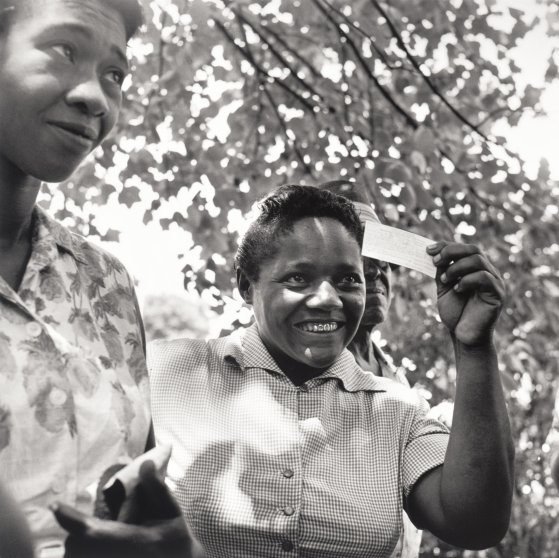 Young woman receives her voter registration card, Fayette County, TN