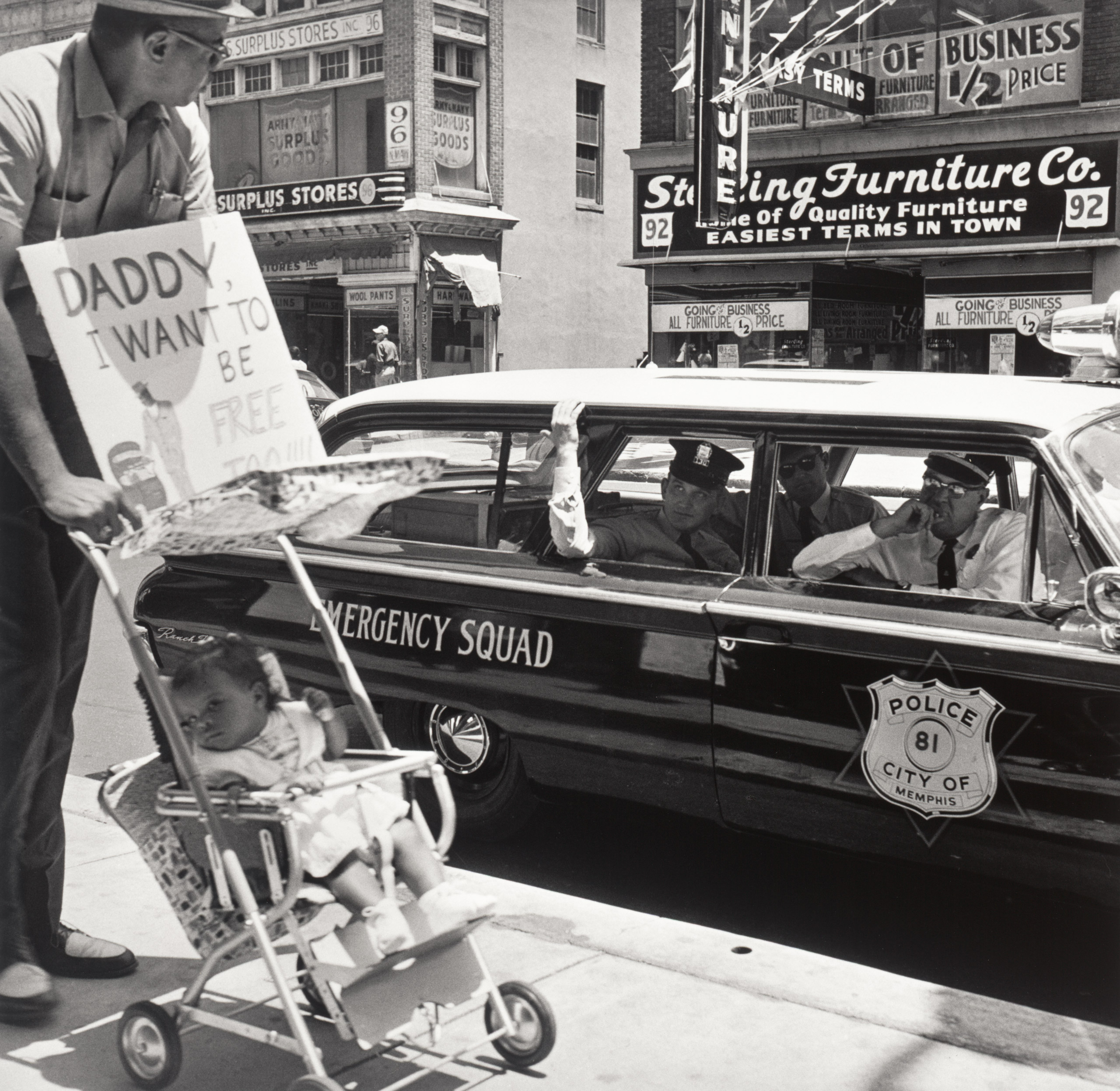 William Edwin Jones pushes daughter Renee                               Andrewnetta Jones (8 months old) during protest march                               on Main St. in Memphis Tennessee. August 1961