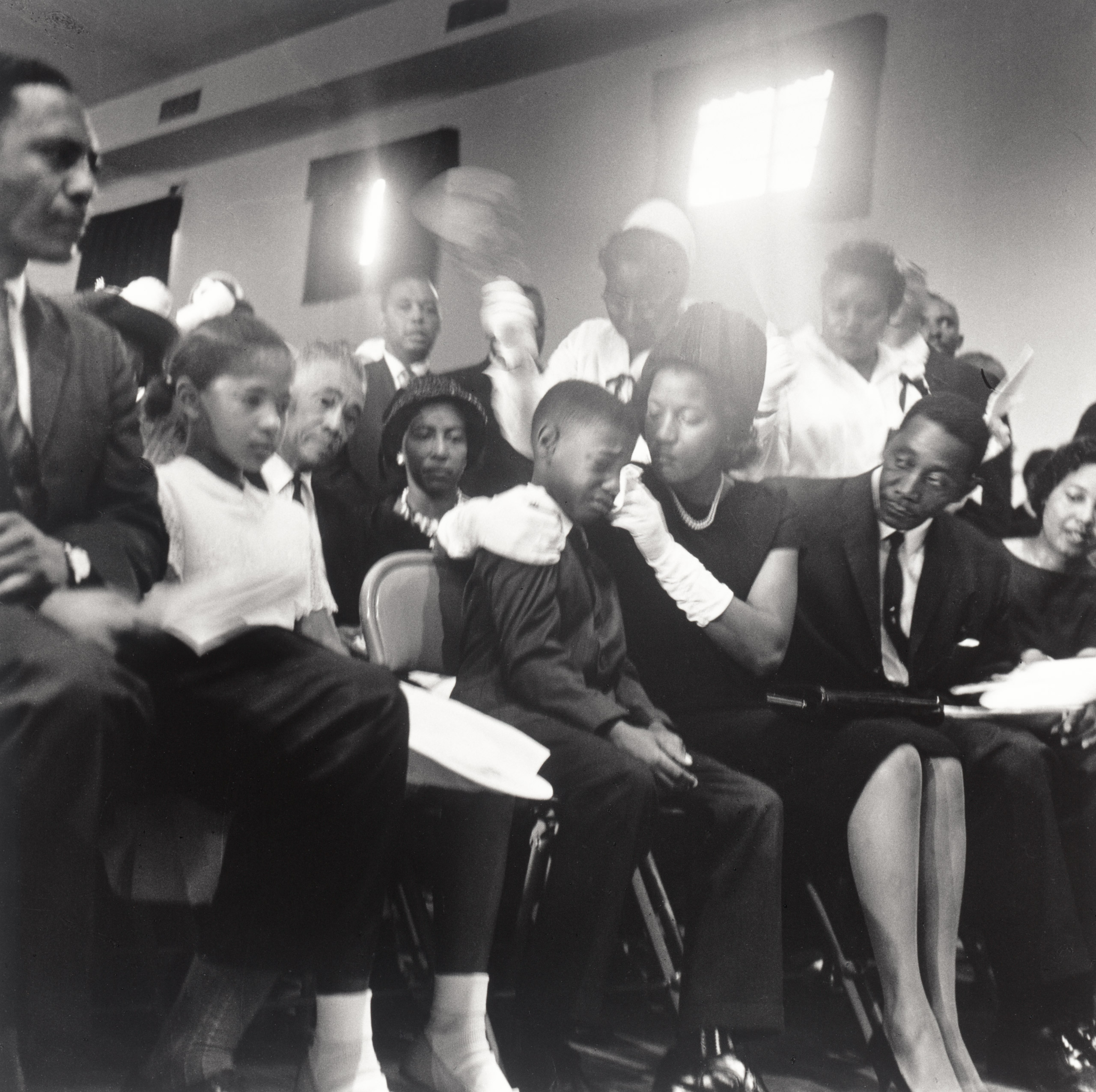 Mrs. Medgar Evers and family - she comforts her eldest son at Medgar Evers' funeral, Jackson MS                               June 15, 1963.