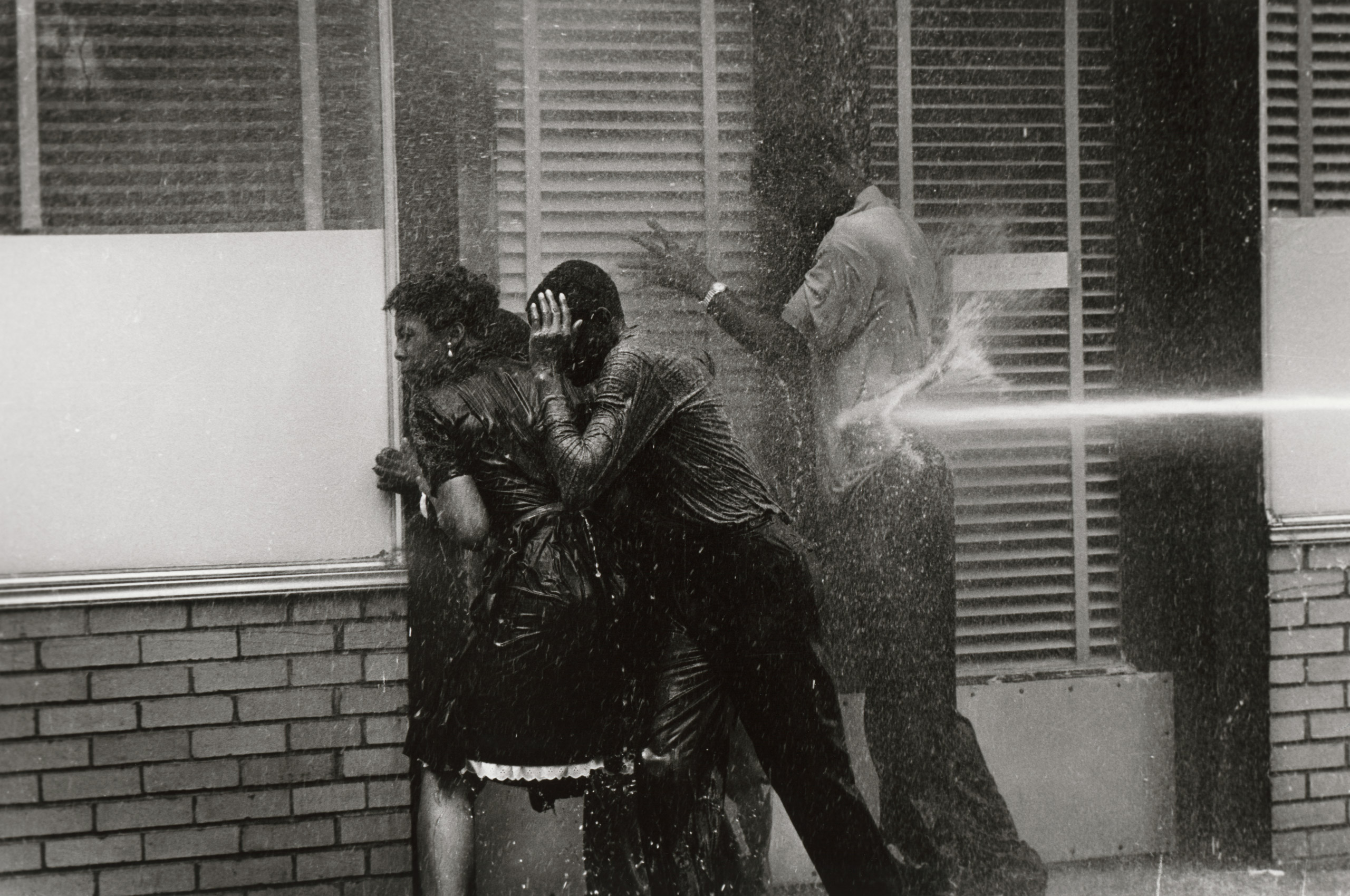 Alabama Fire Department aims high-pressure water hoses at civil rights demonstrators, May 1963.