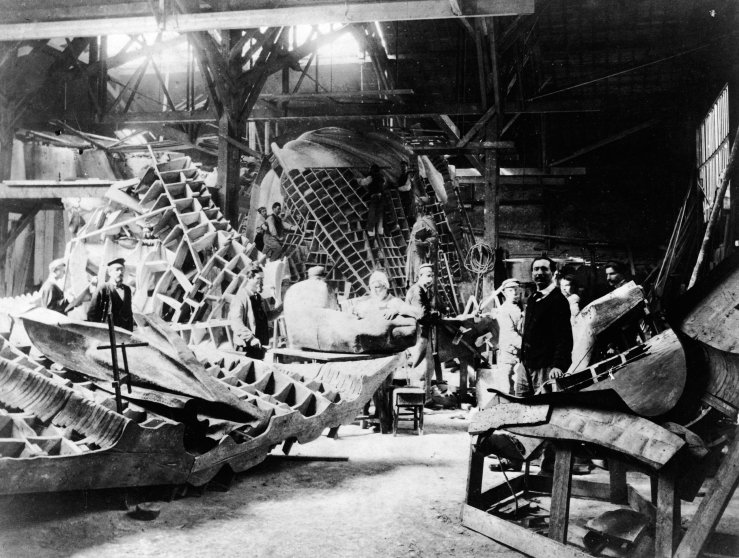 View of portions of the Statue of Liberty during its construction in the workshop of French sculptor Frederic Auguste Bartholdi, Paris, France, circa 1880. Bartholdi stands at left.