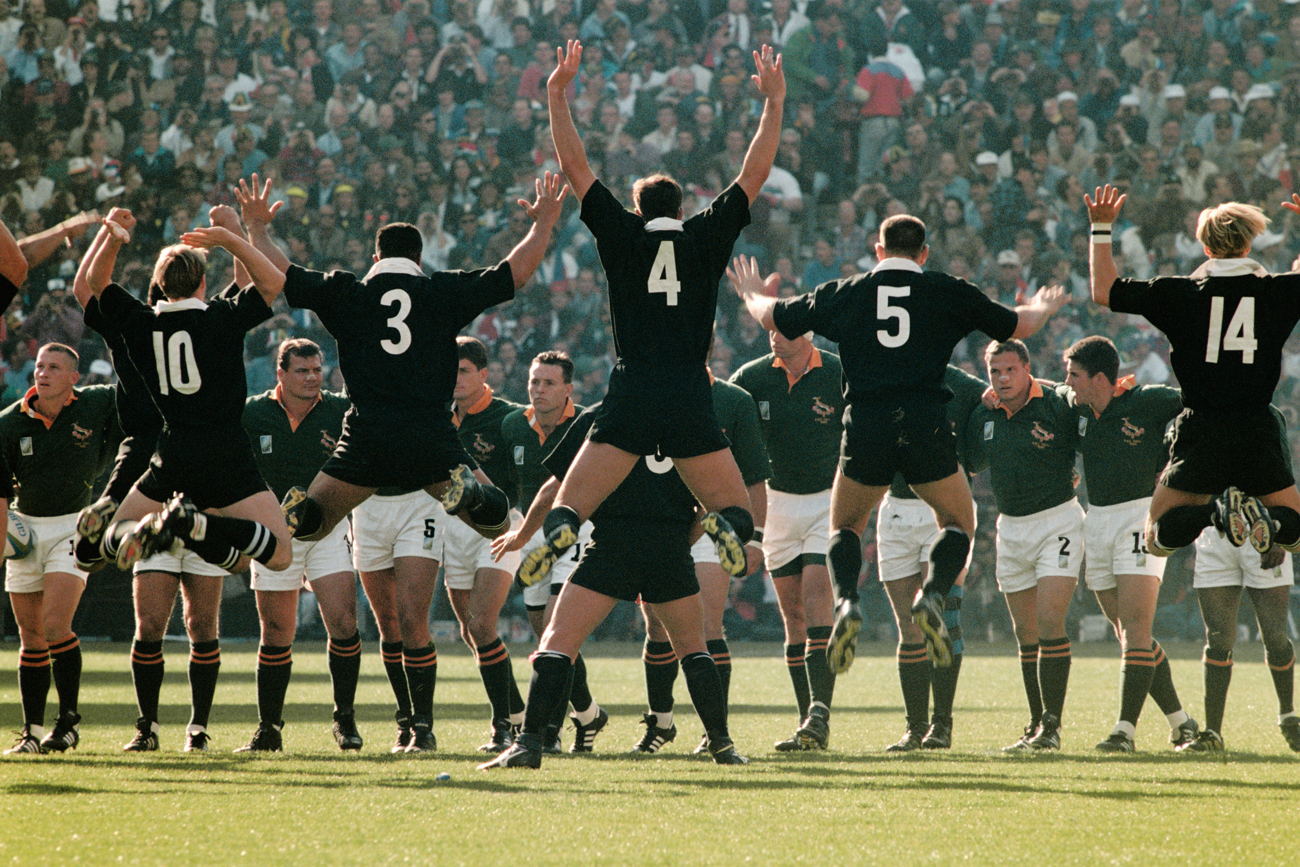 New Zealand's players perform their famous Haka in front of the South African team before the 1995 Rugby Union World Cup final.
