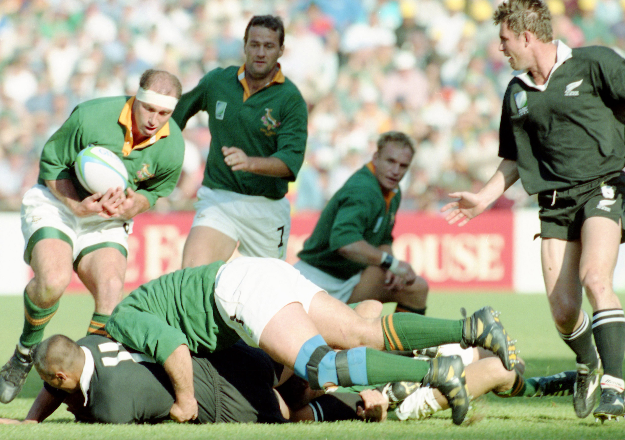 New Zealand player Jonah Lomu, bottom left, is tackled by South African players during the Rugby Union World Cup Final between South Africa and New Zealand at Ellis Park, Johannesburg, on June 24, 1995. South Africa defeated New Zealand 15 - 12, after extra time had been played.