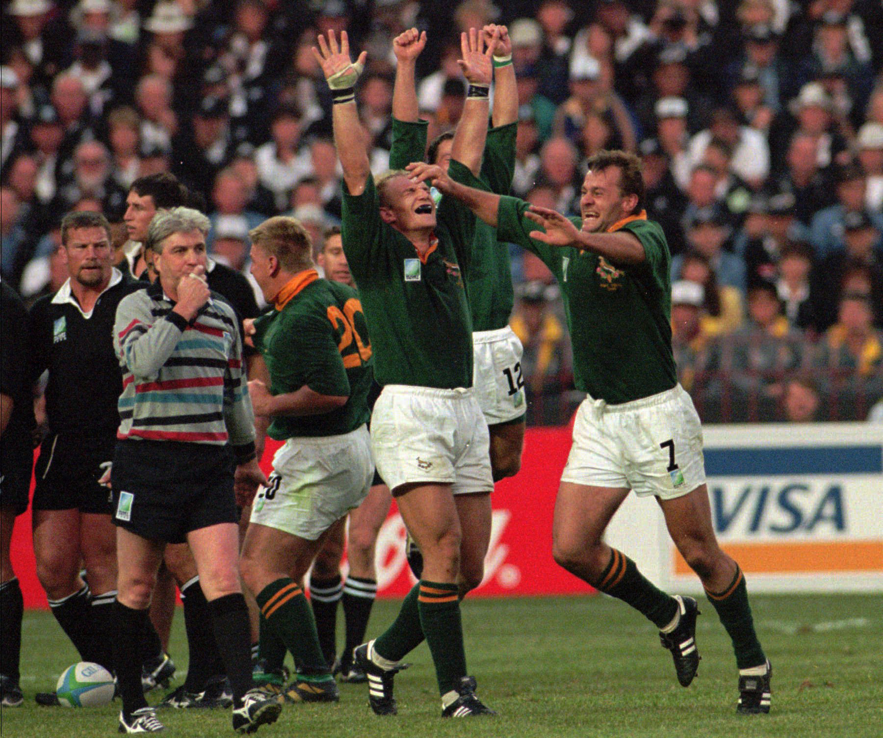 South African captain Francois Pienaar throws his arms in the air as referee Ed Morrison blows the final whistle as his team won the Rugby World Cup over New Zealand in the final 15-12 at Ellis Park, Johannesberg, June 24, 1995.