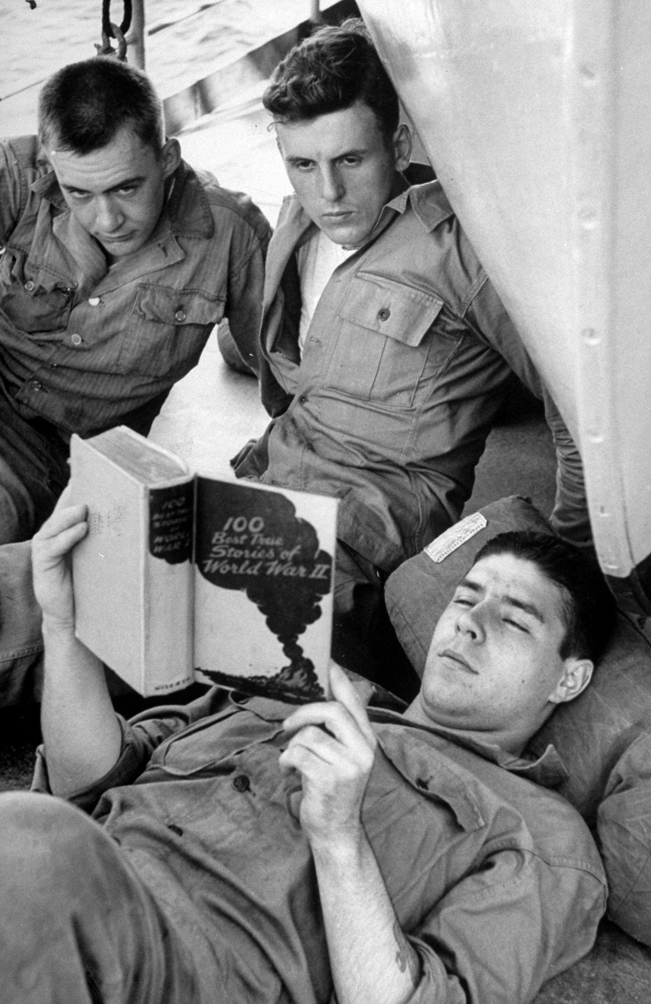 <b>Caption from LIFE.</b> Still in the dark about mission, GI's read about war they were too young to serve in.
