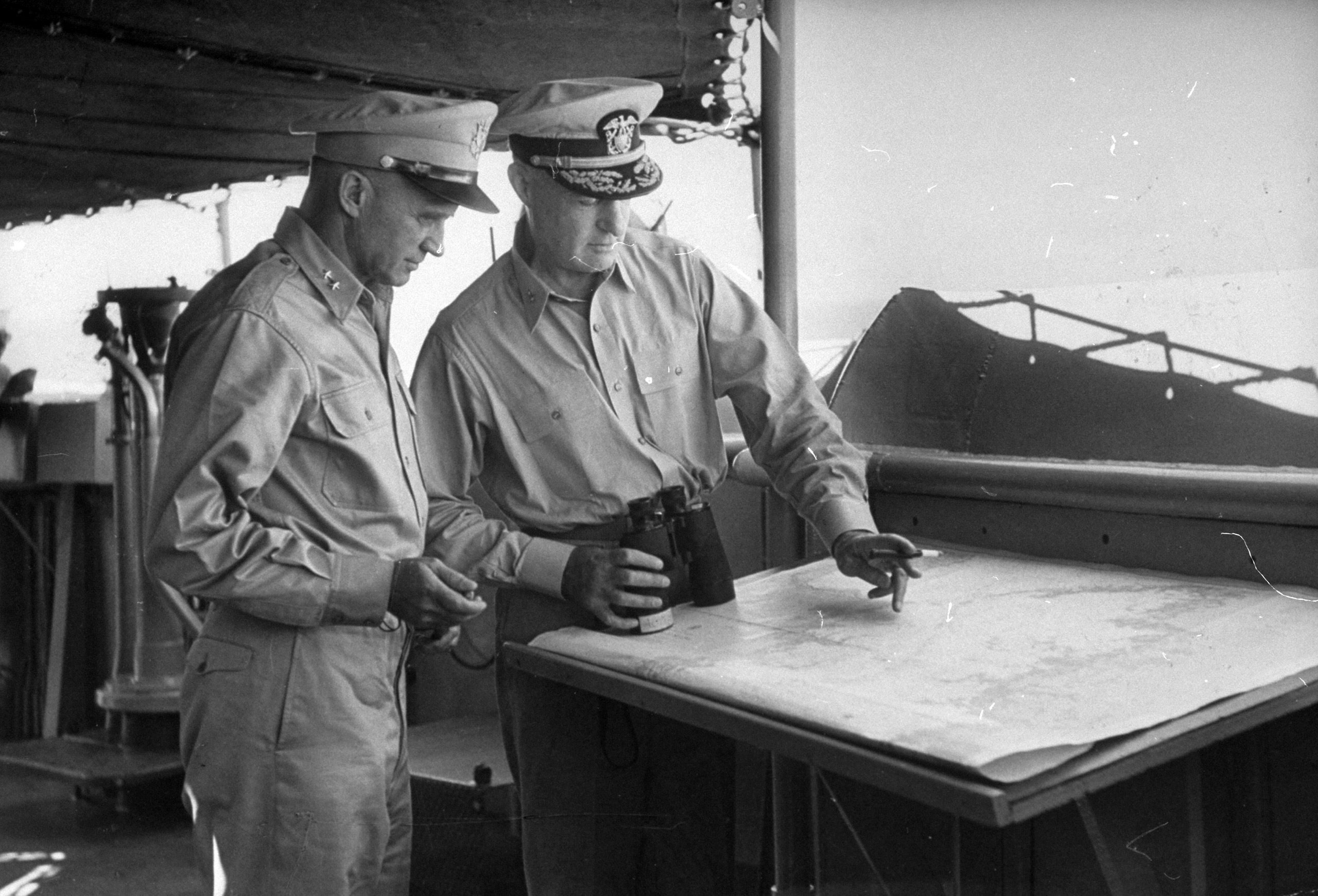 <b>Caption from LIFE.</b> Commanders, 1st Cavalry's General Hobart R. Gay (left), Rear Admiral J.H.Doyle, discuss typhoon menace.