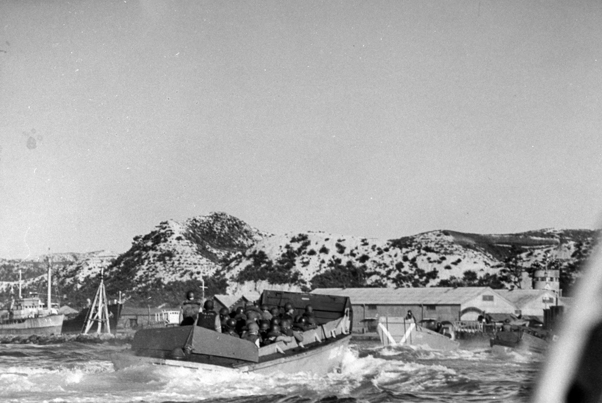 <b>Caption from LIFE.</b> Jammed with men, an LCVP speeds ashore. Lack of opposition was especially fortunate since task force was in no shape for sharply contested beachhead.