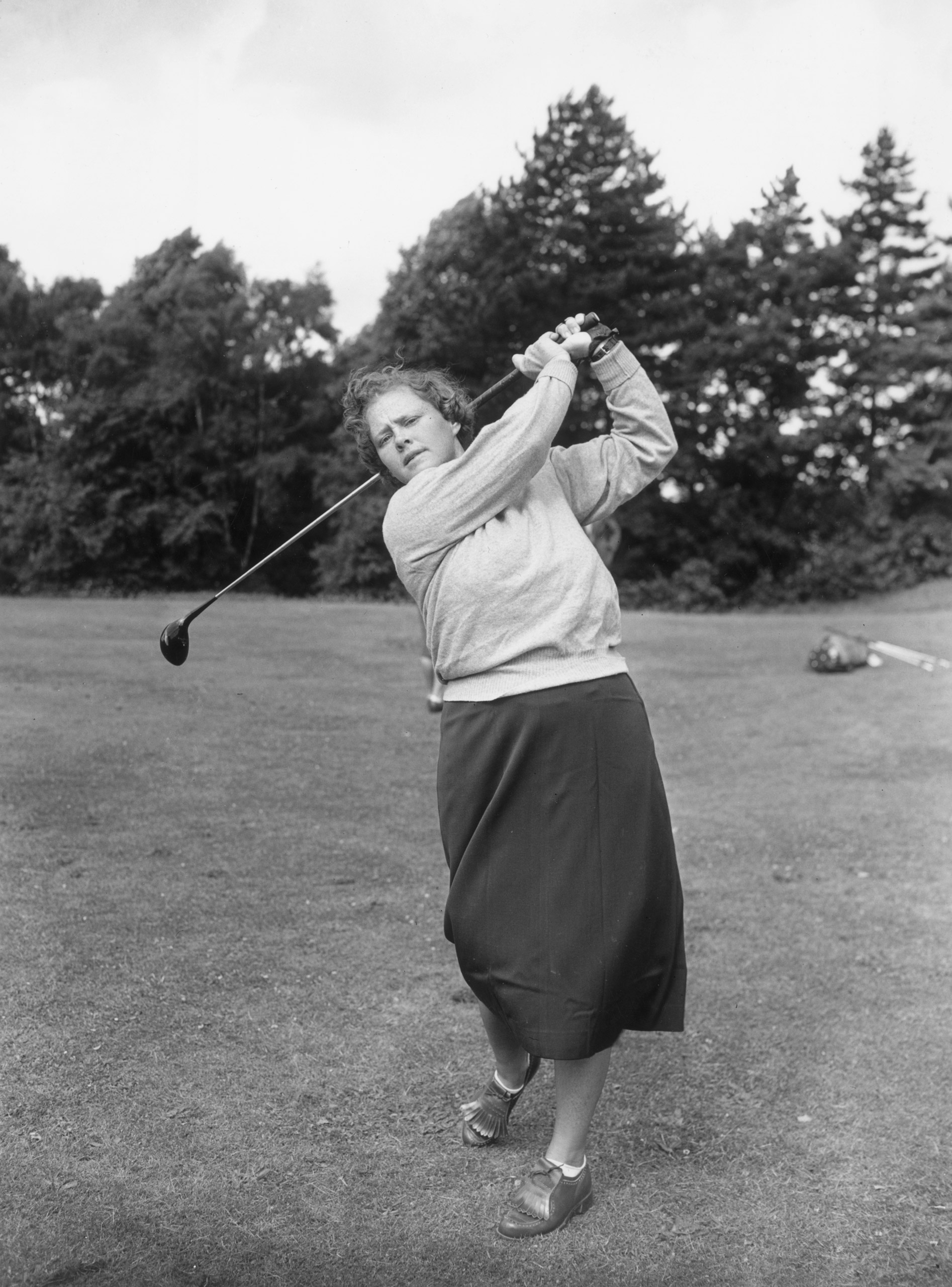 One of America's top ranking professional golfers Patty Berg practicing at Sunningdale, 1951. She was one of the founders of the LPGA (along with Zaharias) and TIME once noted that her father encouraged her to start golfing so she would stop playing football on a  neighborhood boys team.