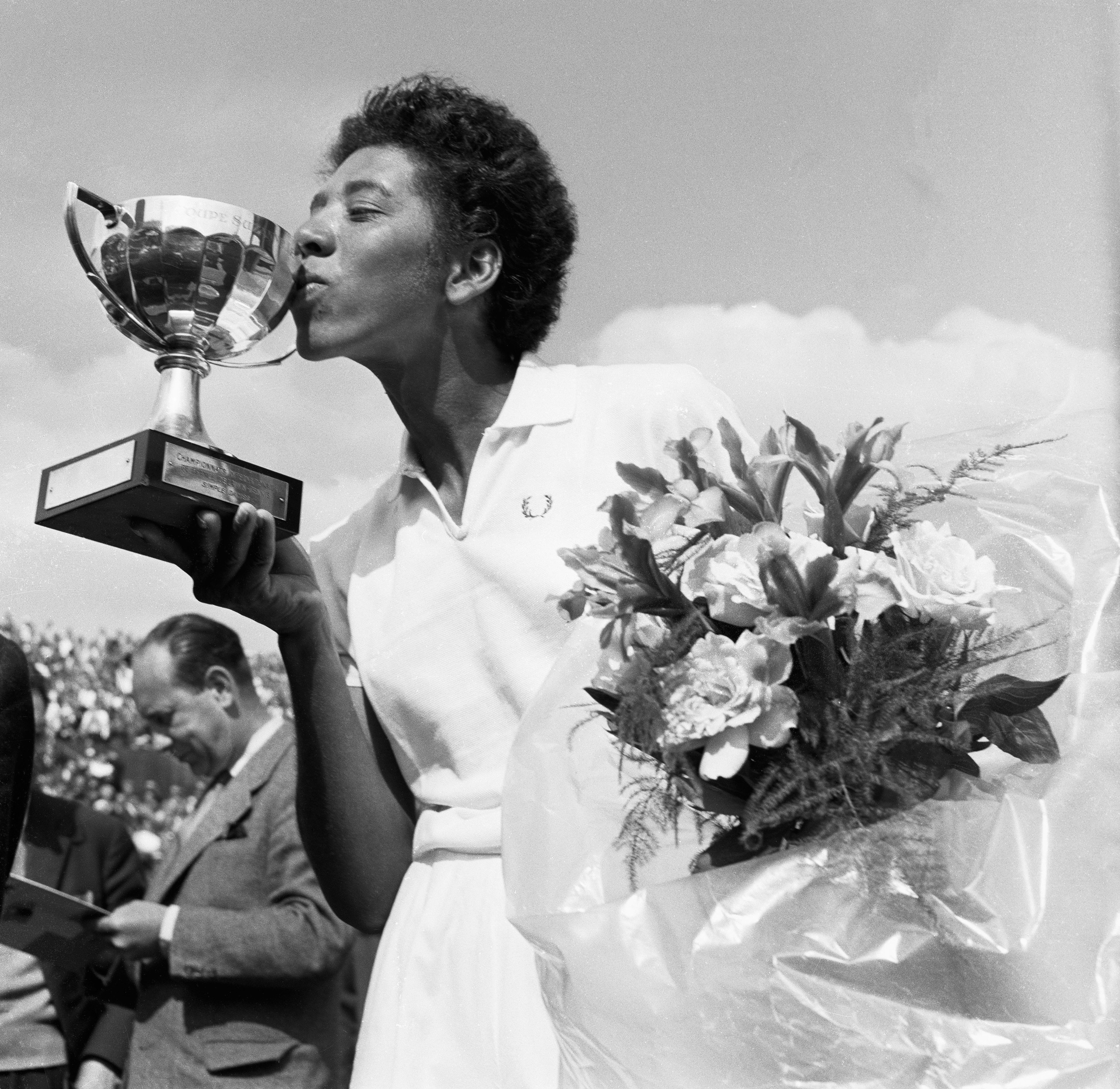 "Althea Gibson kisses the cup she was rewarded with after having won the French International Tennis Championships in Paris, May 26, 1956. Gibson broke the U.S. national championships color barrier and was on the <a href=""http://time.com/vault/issue/1957-08-26/page/1"">cover</a> of TIME in 1957."