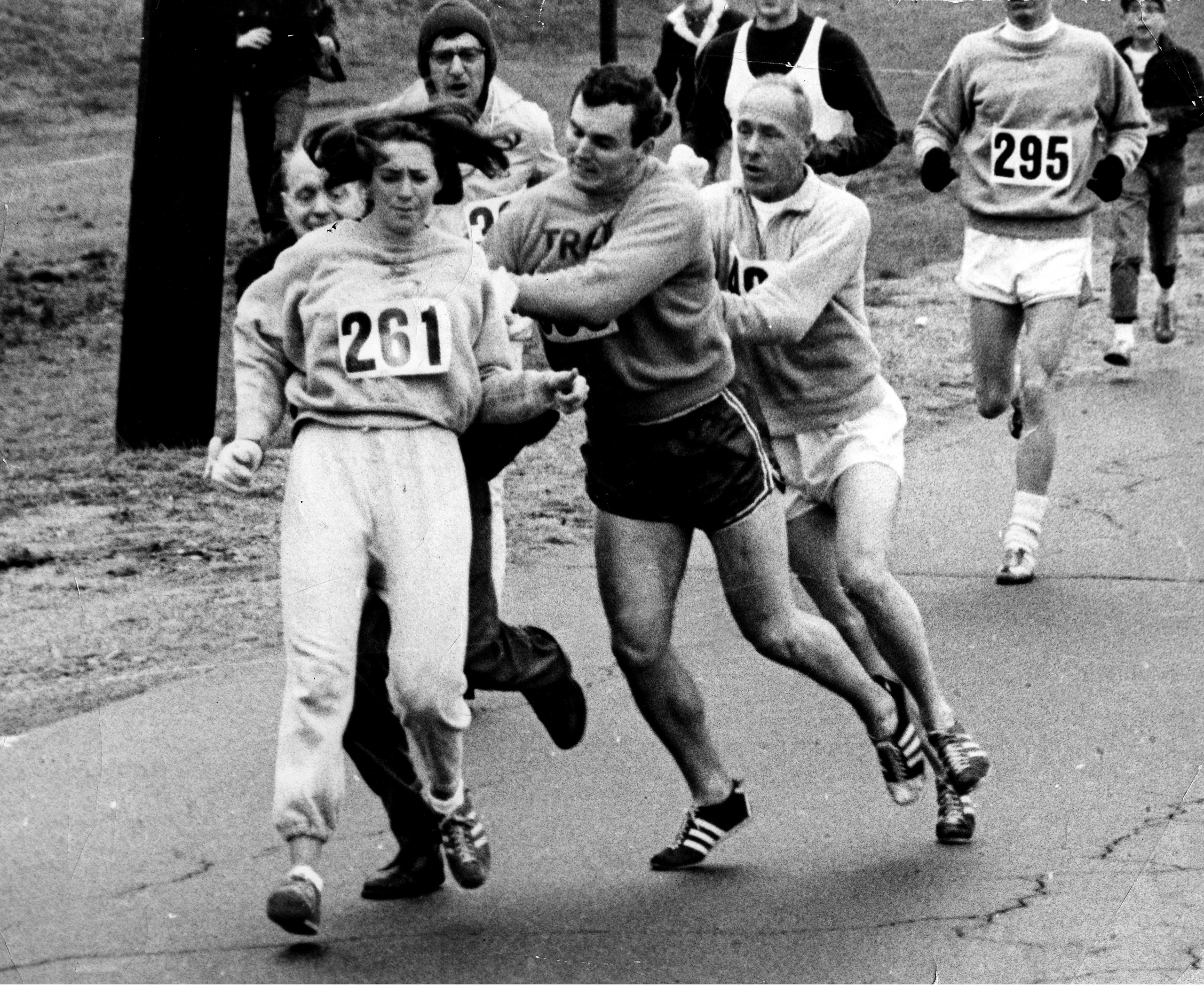 "Kathrine Switzer roughed up by Jock Semple during the Boston Mararthon, April 19, 1967, the year she broke the gender barrier for the race. ""I was so embarrassed and upset, but if I dropped out, everyone would have said that a woman couldn't do it,"" she <a href=""http://time.com/vault/issue/1996-04-15/page/86"">later</a> told TIME."