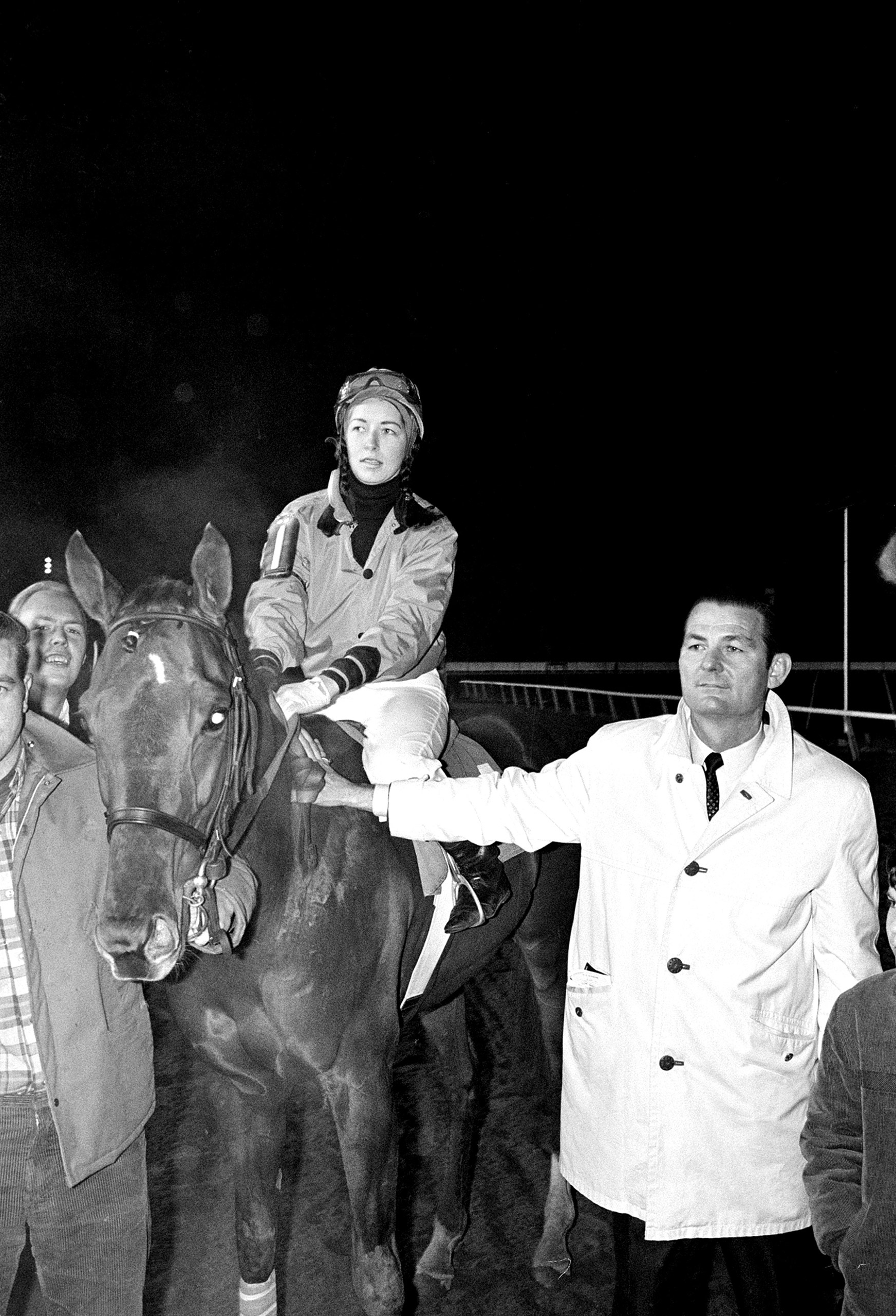 Barbara Jo Rubin, 19-year-old veterinary student from Miami, holds the reins of her horse Cohesion, shortly after she rode him to victory at the racetrack of Charles Town, W.V., thus becoming the first female jockey to win a major pari-mutuel flat race in the United States, on Feb. 23, 1969. Later that year she became the first woman to ride in the Kentucky Derby. It wasn't an easy ride: TIME noted that she had had her dressing-room window smashed by a rock during a jockey boycott.