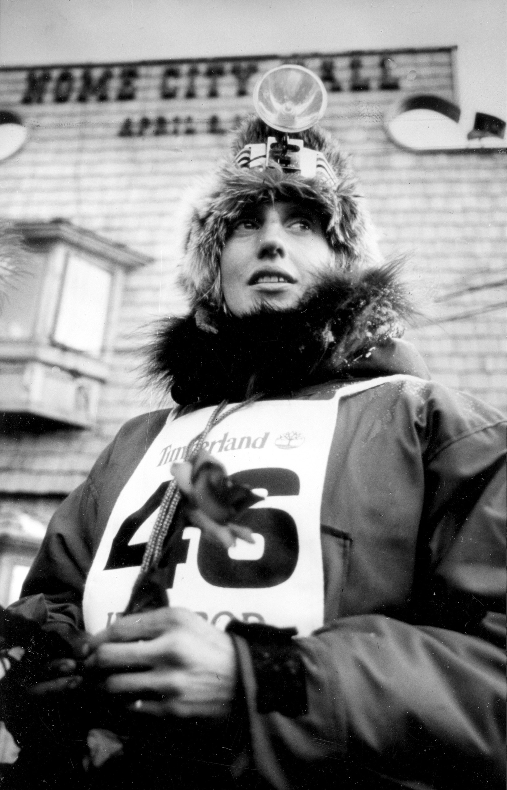 Musher Libby Riddles stands in front of the City Hall at Nome, Alaska, March 20, 1985, shortly after crossing the finish line, thus becoming the first female champion of the Iditarod Trail Sled Dog Race.  Two weeks into the 18-day trek, while her competition opted to sit out a fierce snowstorm,  TIME reported,  the musher from Teller, Alaska, pressed on with her team of 13 dogs.