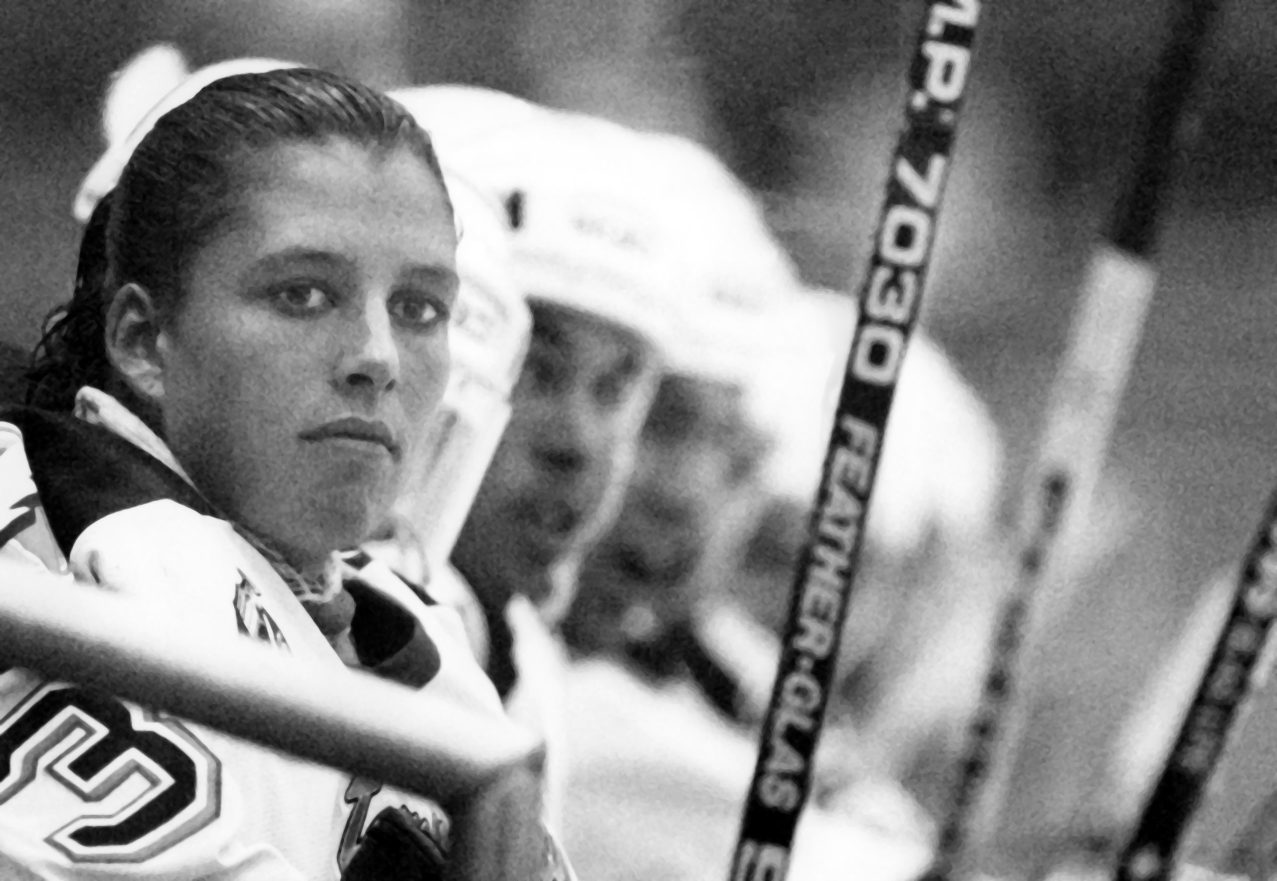 Goalie Manon Rheaume of the Tampa Bay Lightning sits on the bench during an NHL preseason game against the St. Louis Blues on Sept. 23, 1992, at the Expo Hall in Tampa, Fla. Rheaume was the first woman to play in the NHL, though she didn't appear in the regular season. After a 1992 game, TIME noted that a sportswriter had just one question for her:  'Did you break a nail?''