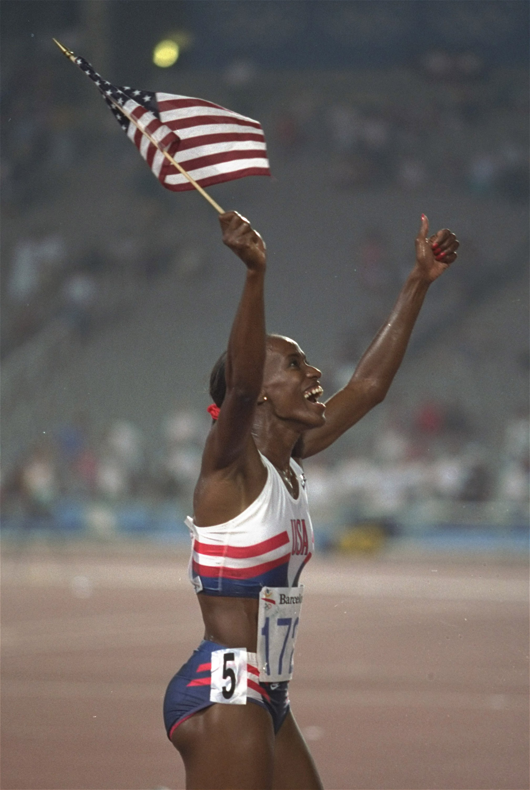 The USA's Jackie Joyner-Kersee walks the track at the Olympic Stadium in Barcelona on Aug. 2, 1992, after winning the gold medal in the Heptathlon competition during the Summer Olympic Games. She was the first woman ever to pass 7,000 points in the event.