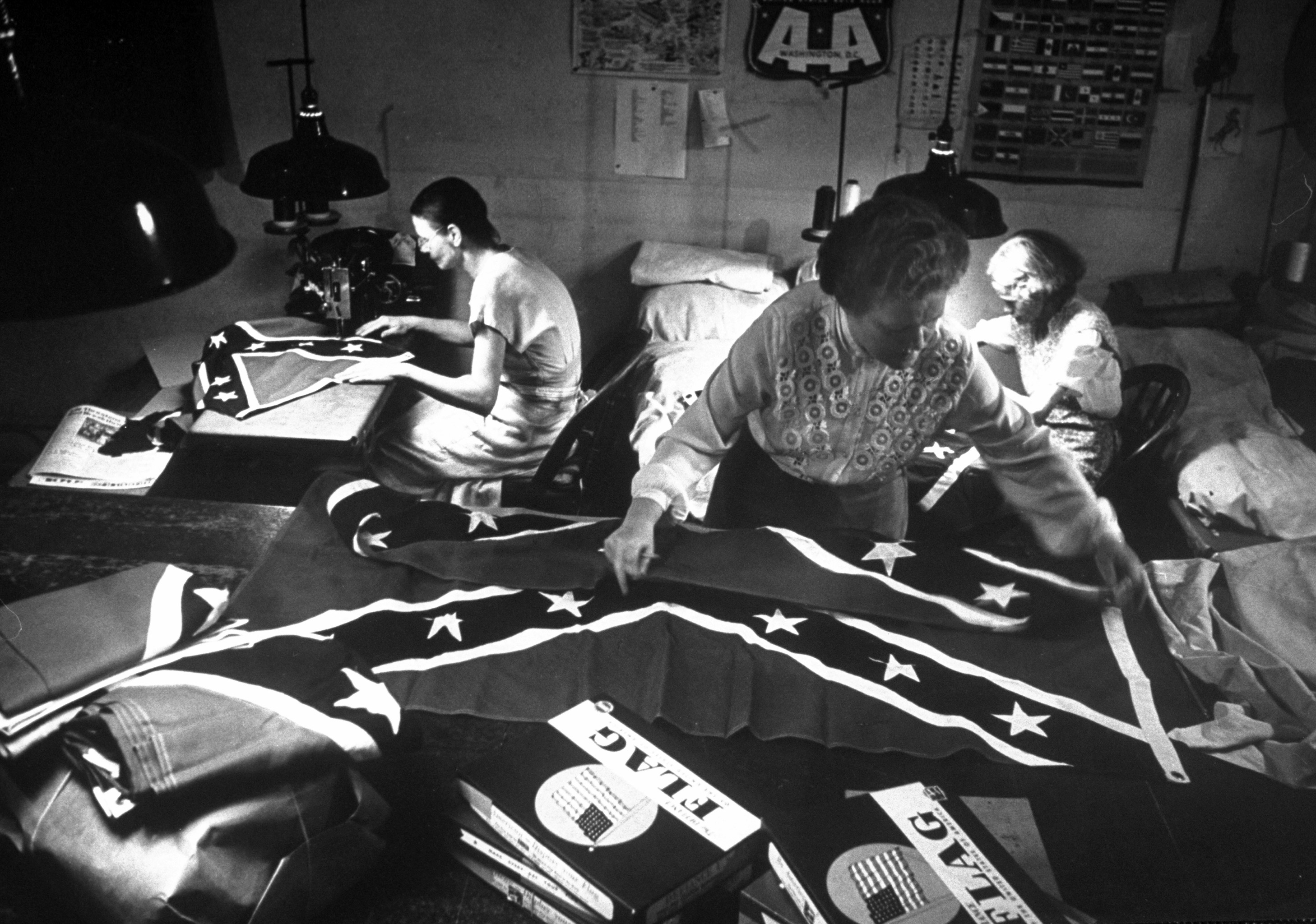 <b>Caption from LIFE.</b> Flag factories like this one in Washington are swamped with orders for flags from tiny ones for dime-store sale to 5-by-8 foot silk ones at $100 each.