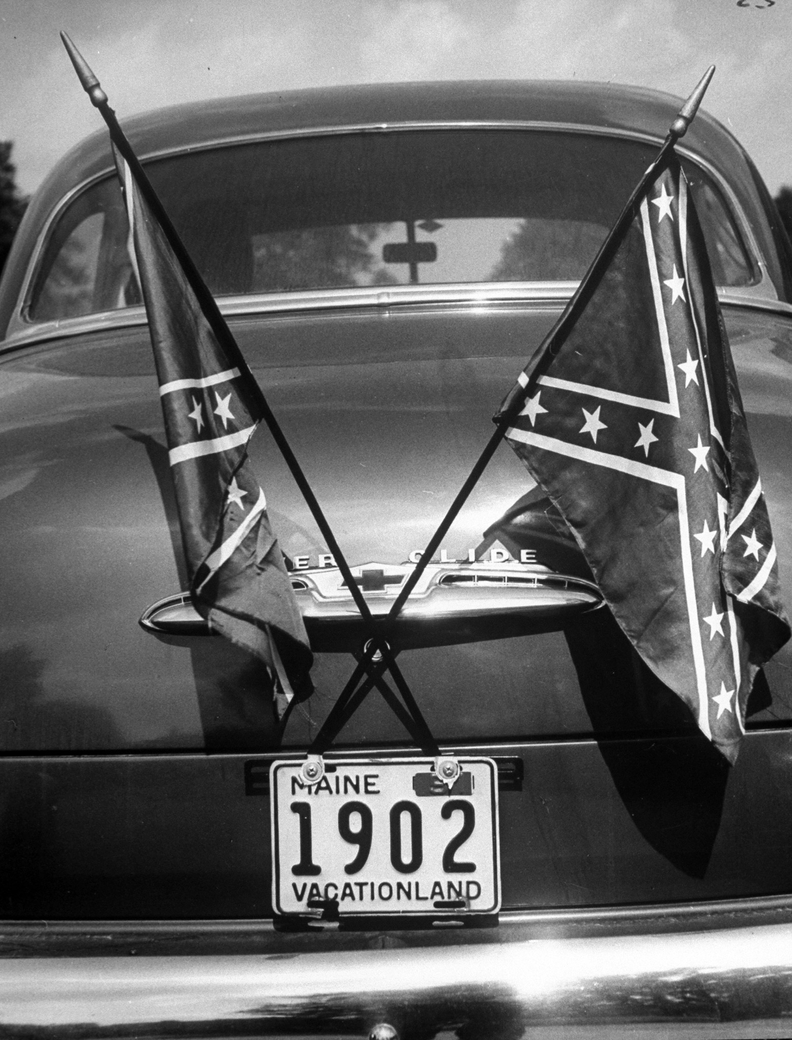 <b>Caption from LIFE.</b> Dam Yankee's car would enrage Daughters of the Confederacy, who have spoken out bitterly against using flags like fox tails on cars' radiator caps.