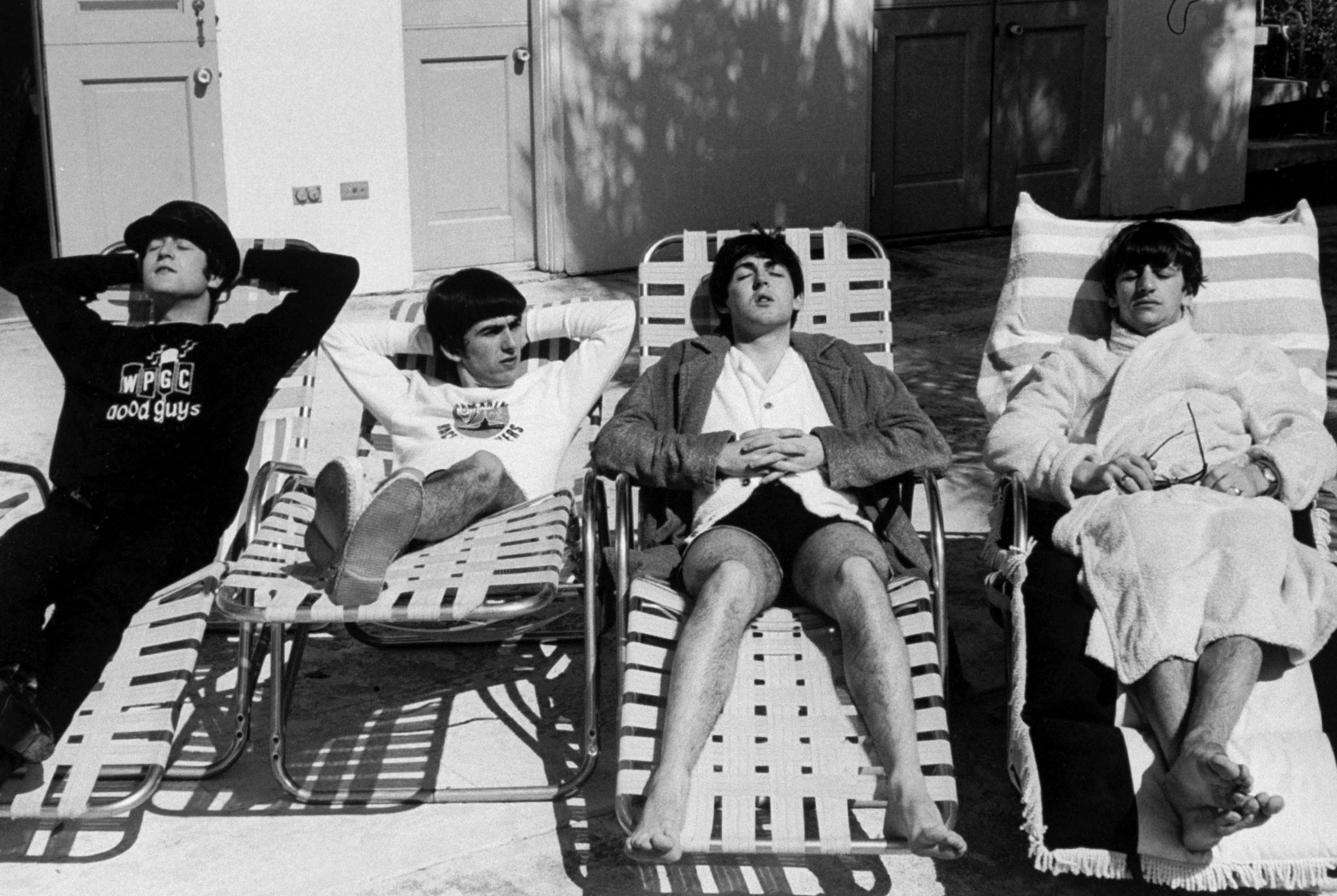 The Beatles relaxing poolside, February 1964.