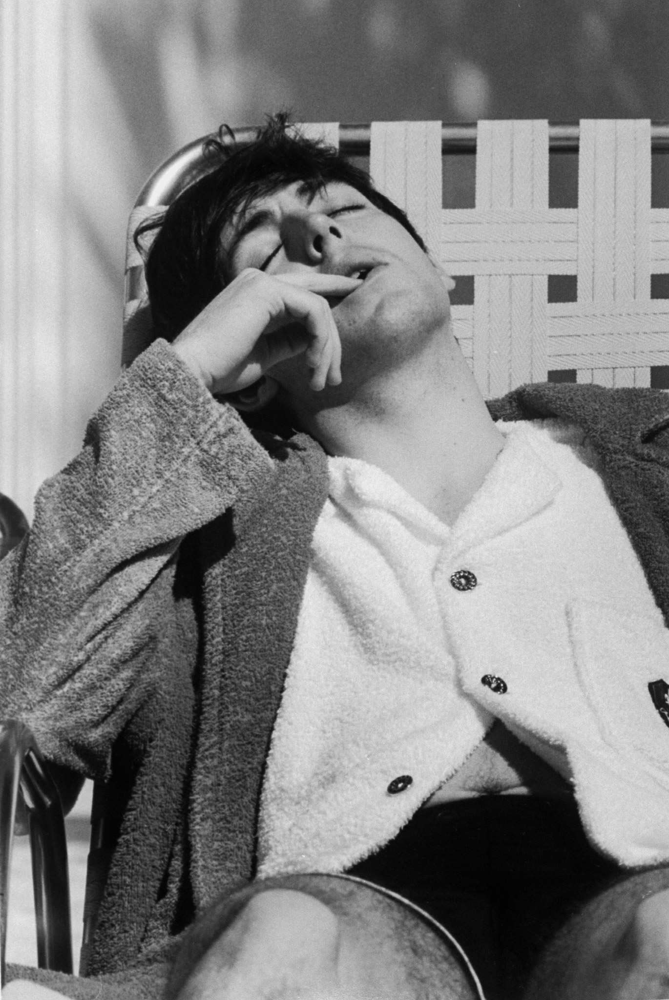 Paul McCartney relaxing on a lounge chair, February 1964.