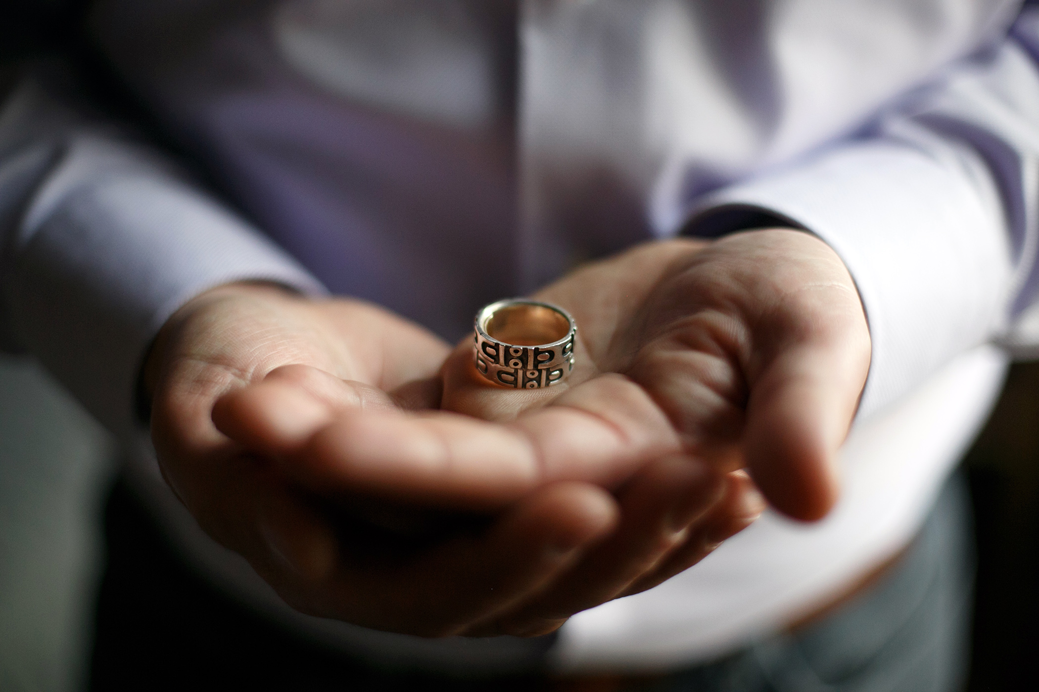 Jim Obergefell was married to his husband John Arthur on a medical jet in Maryland shortly before Arthur died of ALS. Obergefell holds his wedding band that has been fused together with Arthur's ashes and wedding ring.