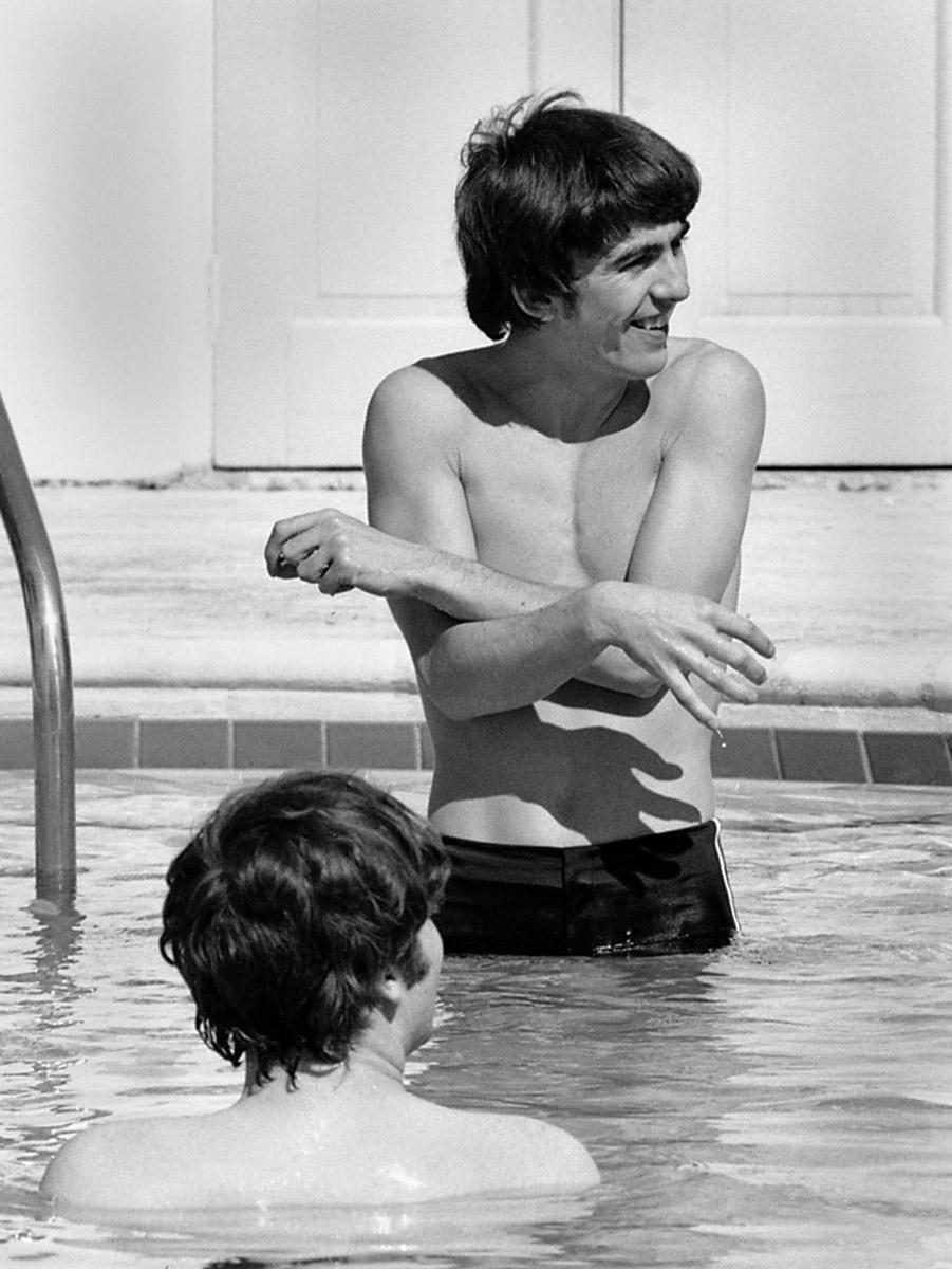 George Harrison and John Lennon in a swimming pool, Miami, Florida, February 1964.