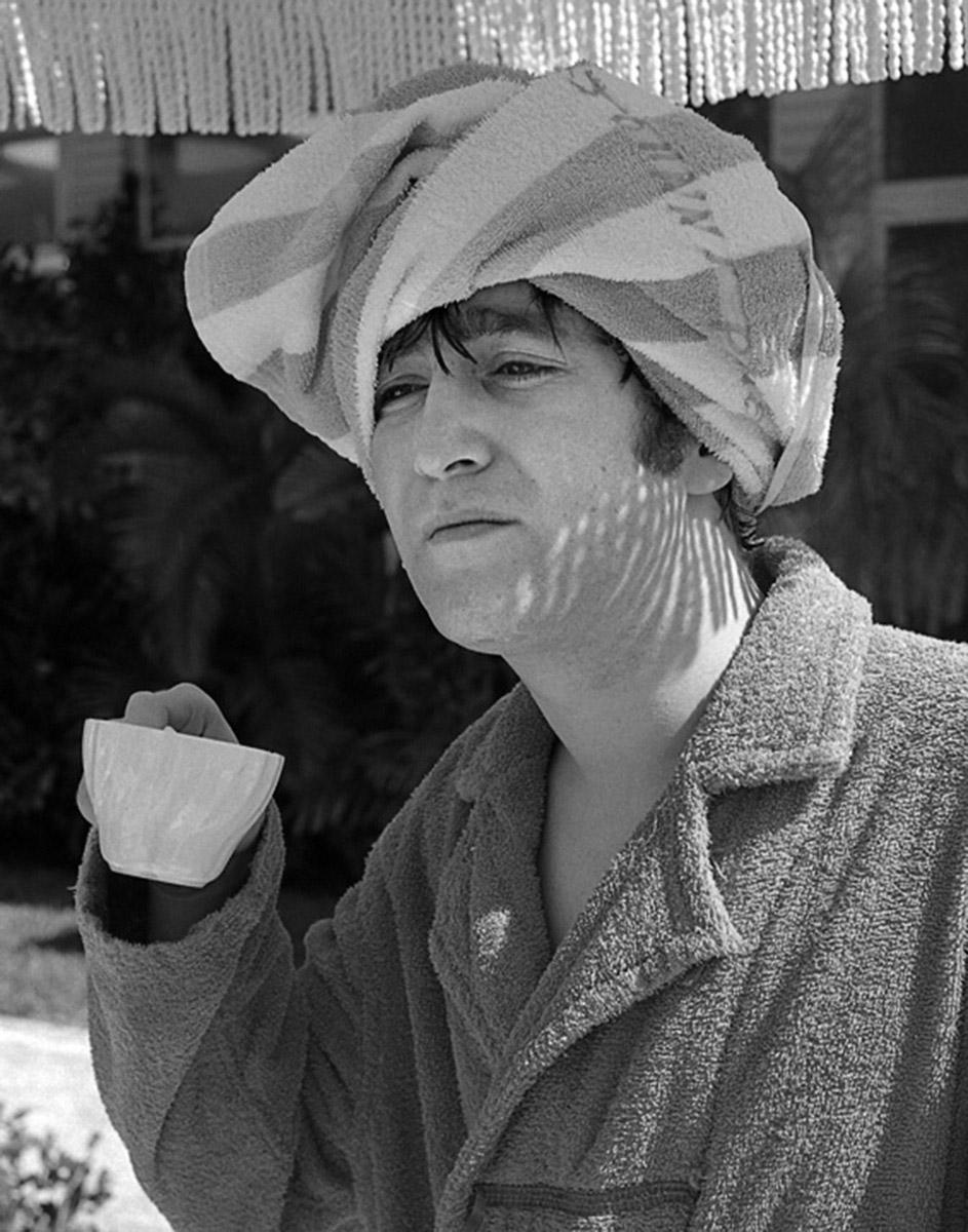 John Lennon drinking tea, poolside in Miami, Florida, February 1964.