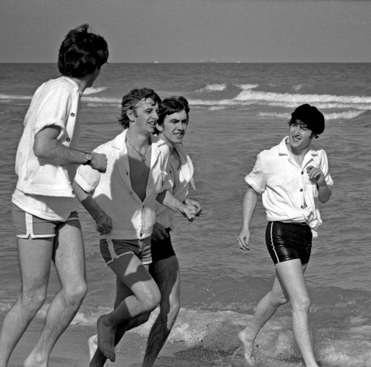 The Beatles running on the beach in Miami, Florida, February 1964.