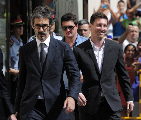 Barcelona football star Lionel Messi (R), his brother Rodrigo and lawyer Cristobal Martell (L) leave the courhouse in the coastal town of Gava near Barcelona on September 27, 2013 after an audience on tax evasion charges.