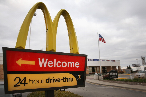 A sign directs customers to the drive-thru at a McDonald's restaurant on Oct. 24, 2013 in Des Plaines, Ill.
