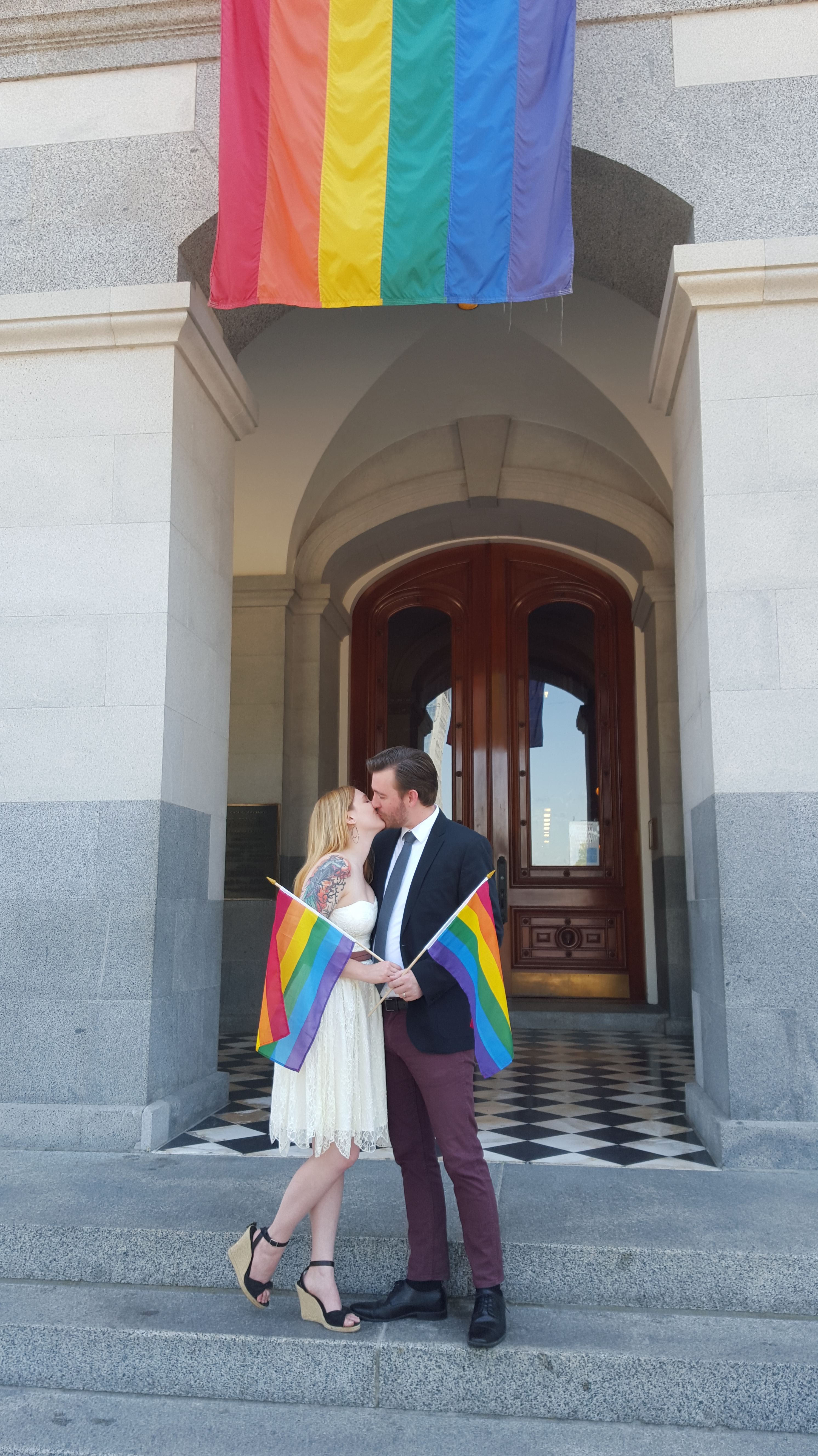 Roxy and Jordan Davis pose for pictures at the California State Capitol building in Sacramento after getting married at the County Clerk/Recorder's Office on June 26, 2015.