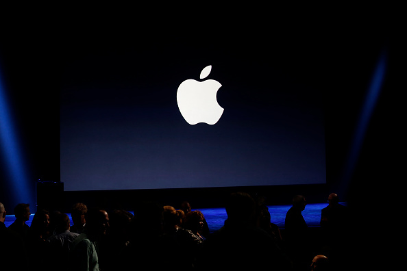 An Apple logo is seen on screen during an event in San Francisco on March 9, 2015.