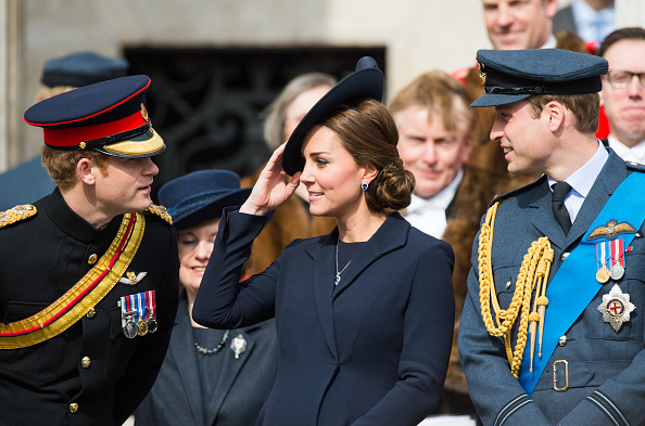 Prince Harry, Catherine, Duchess of Cambridge, and Prince William attend a commemoration for troops who were stationed in Afghanistan in London on March 13, 2015