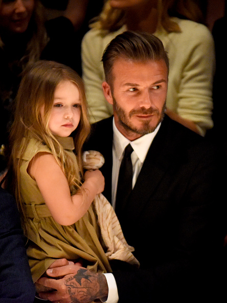 Harper Beckham (L) and David Beckham attend the Burberry  London in Los Angeles  event in Los Angeles on April 16, 2015.