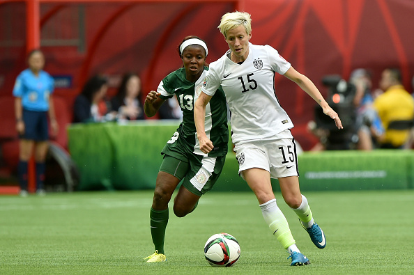 Megan Rapinoe #15 of the United States and Ngozi Okobi #13 of Nigeria during the Group D match of the FIFA Women's World Cup Canada 2015 in Vancouver on June 16, 2015.