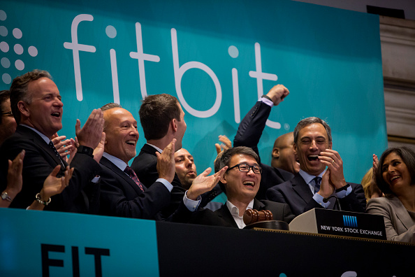 Fitbit Chief Executive James Park (C) rings the bell for the company's IPO debut at the New York Stock Exchange on June 18, 2015.