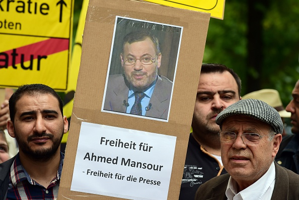 Supporters of ousted Egyptian Islamist president Mohamed Morsi stage a demonstration to ask for the release of detained Al-Jazeera journalist Ahmed Mansour in front of the local court of Berlin's Tiergarten district, where Mansour is being held in custody on June 21, 2015