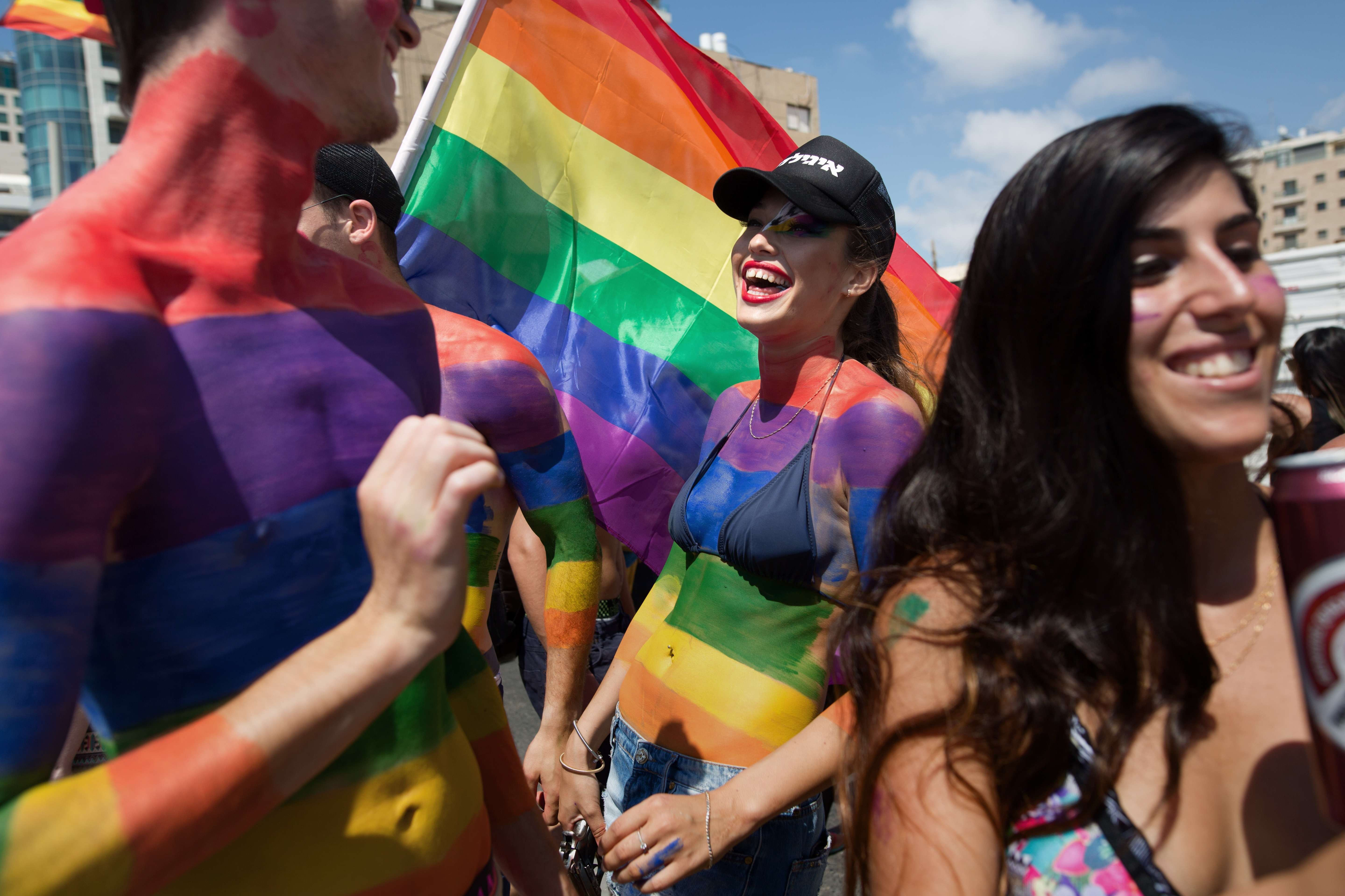 Israelis and foreigners celebrate during the 17th annual gay pride parade in Tel Aviv on June 12, 2015.