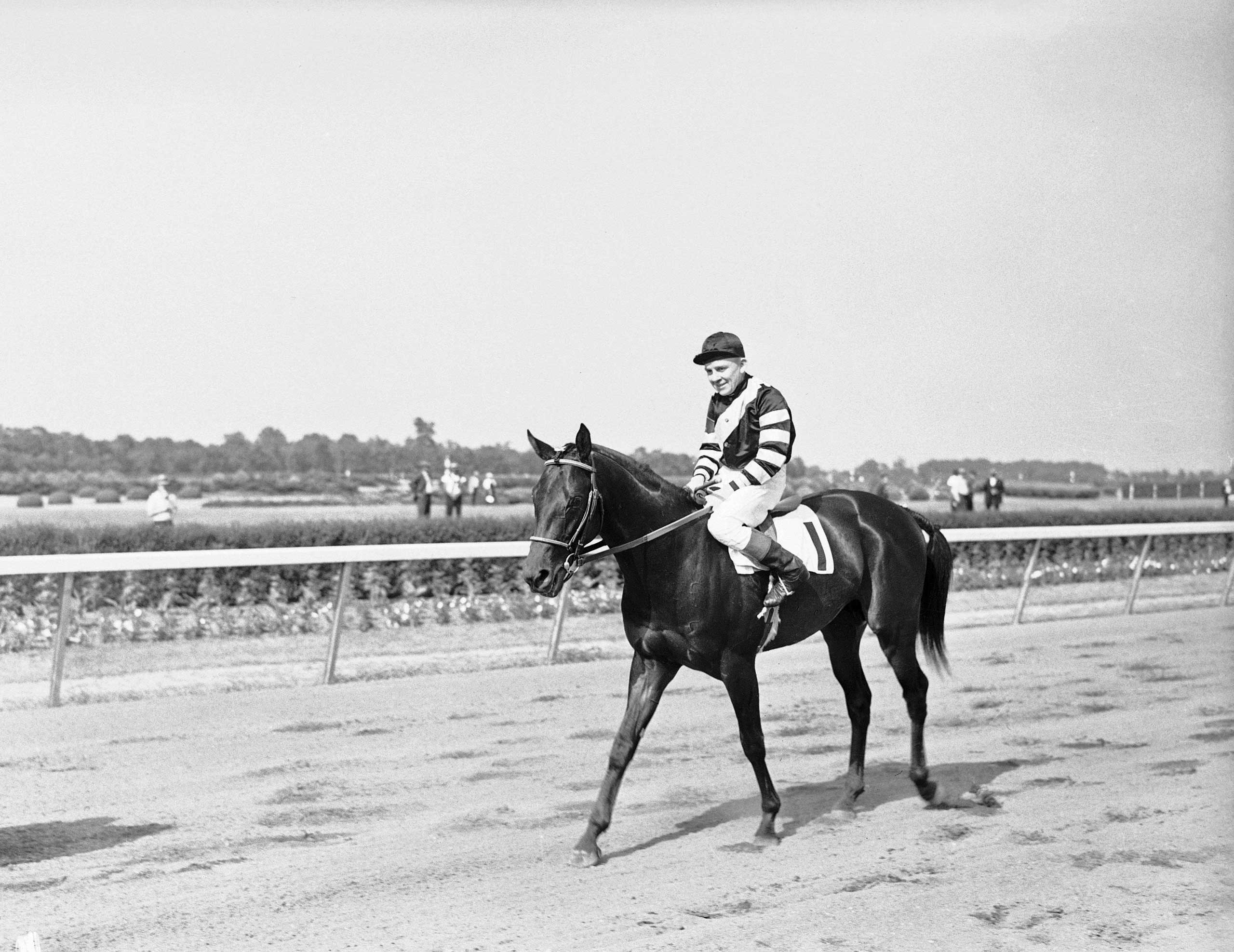 1937: War Admiral with jockey C. Kurtsinger