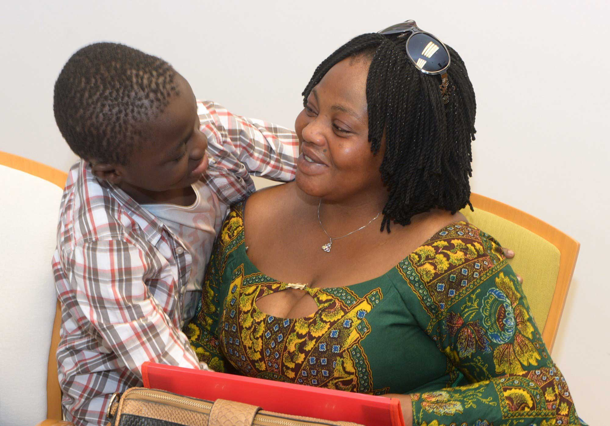 A handout pictured realeased  shows Ivorian boy Adou Ouattara, left, hugging his mother Lucie Ouattara after being reunited with her in Ceuta, on June 8, 2015