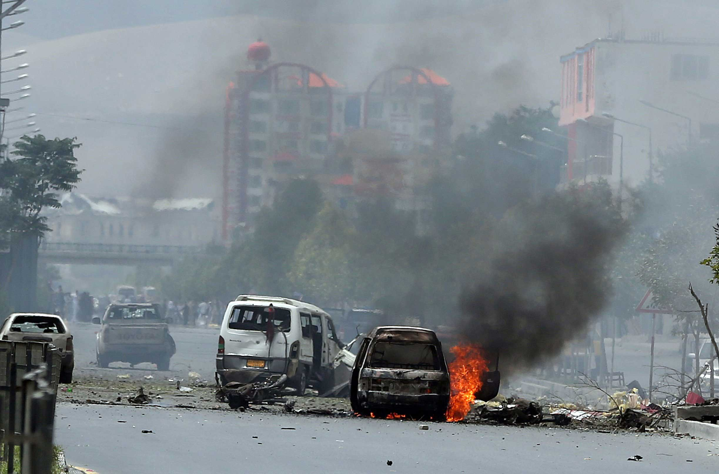 Fire and smokes rise at the site of a suicide-bomb attack during clashes with Taliban fighters in front of the Afghan Parliament, in Kabul, Afghanistan on June 22, 2015.
