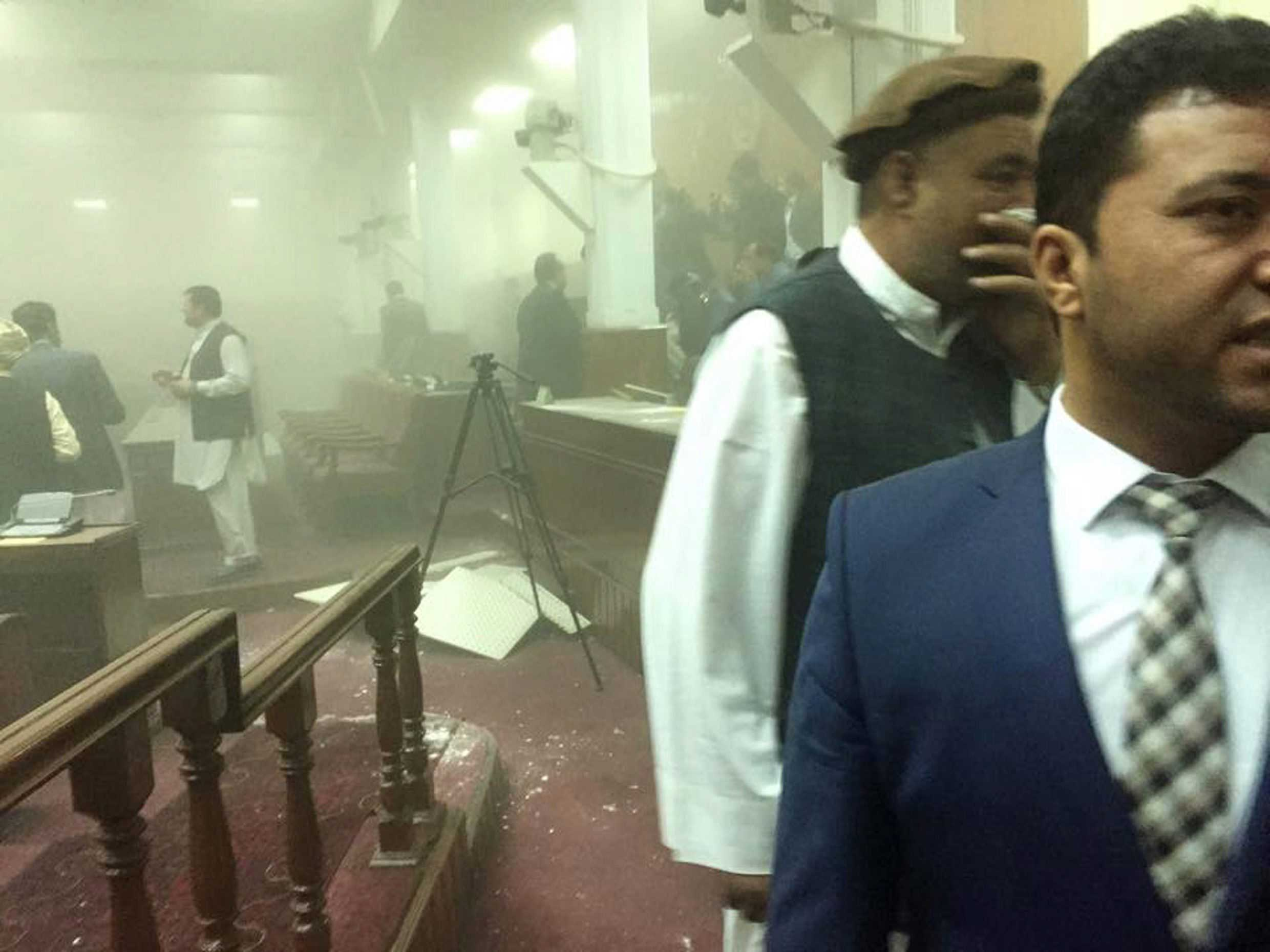 Dr. Najibullah Faiq, shows the scene from inside the Afghan Parliament building following an attack by Taliban militants, in Kabul, Afghanistan on June 22, 2015.
