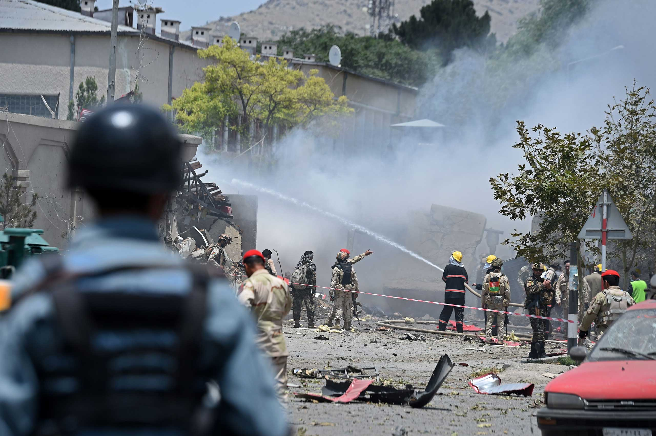 Afghan firefighters work to put out a fire at the site of a suicide bomb attack on the Afghan Parliament building in Kabul, Afghanistan on June 22, 2015.