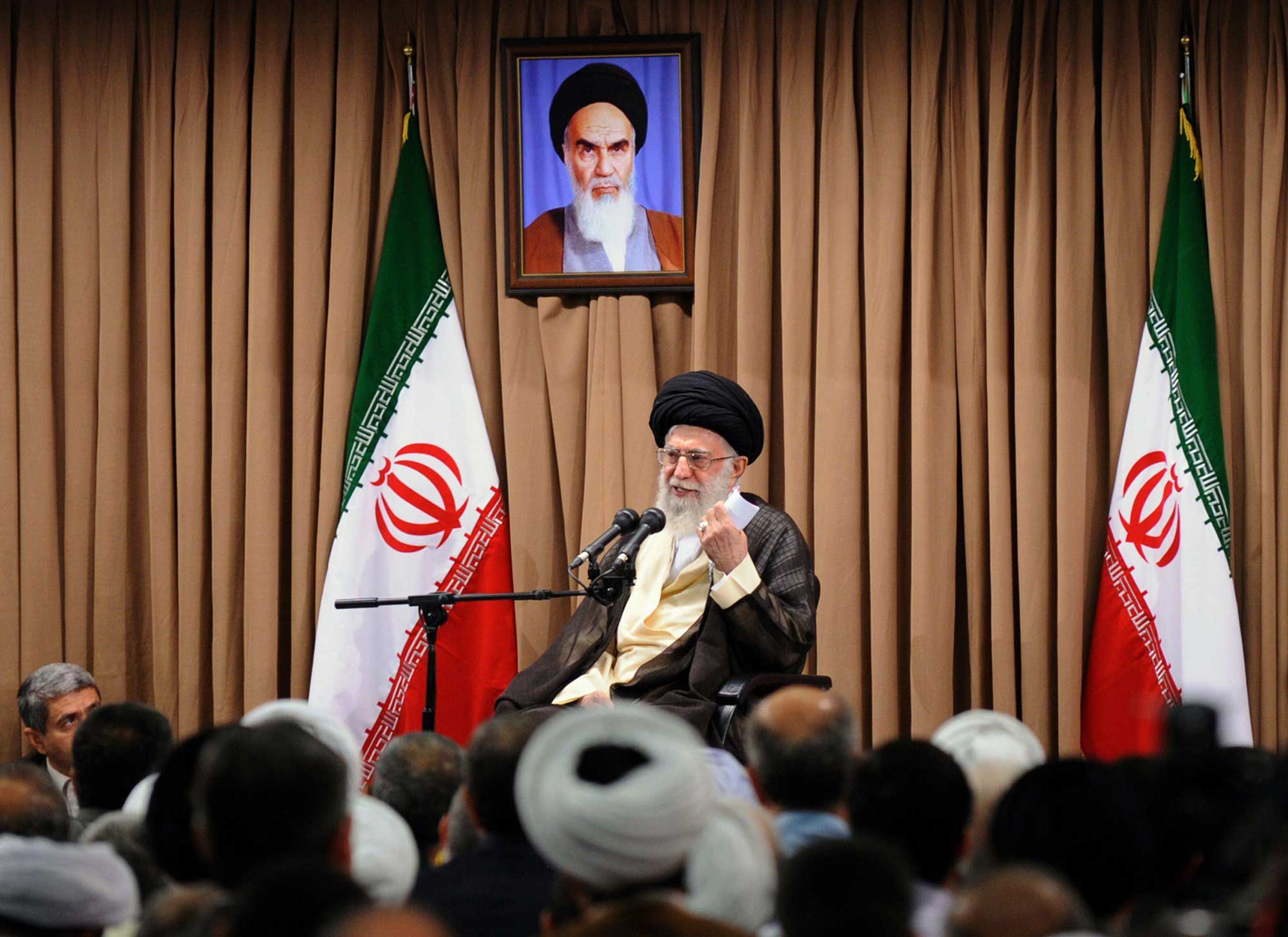 Iran's supreme leader, Ayatollah Ali Khamenei, addresses country's top officials during a meeting  in Tehran in which he restated his country's red lines for a nuclear deal with world powers on June 23, 2015.