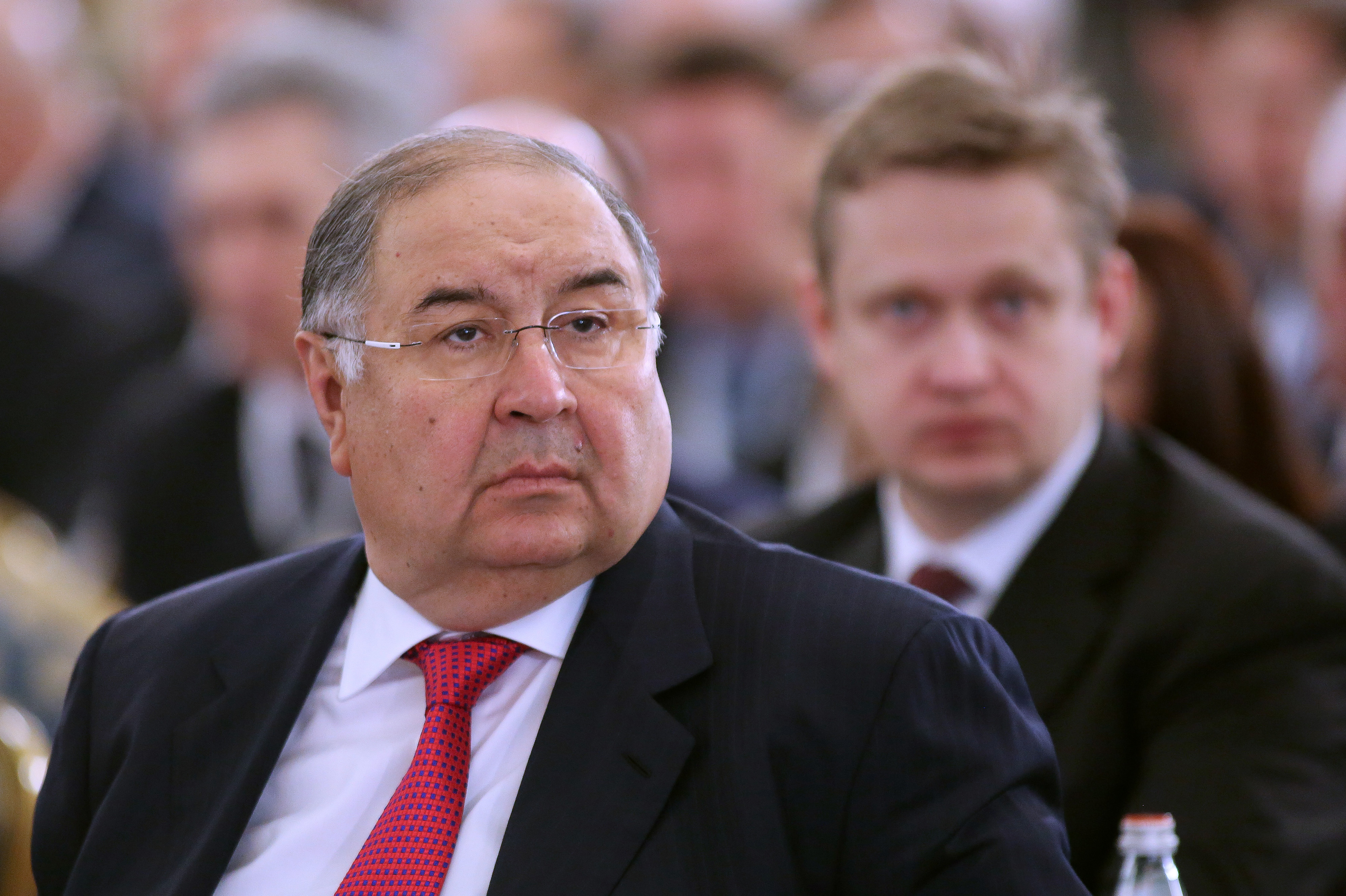 Alisher Usmanov, Russian billionaire and owner of USM Holdings Ltd., left, attends a meeting of the Russian Union of Industrialists and Entrepreneurs (RSPP) during Russia Business Week in Moscow, March 19, 2015.