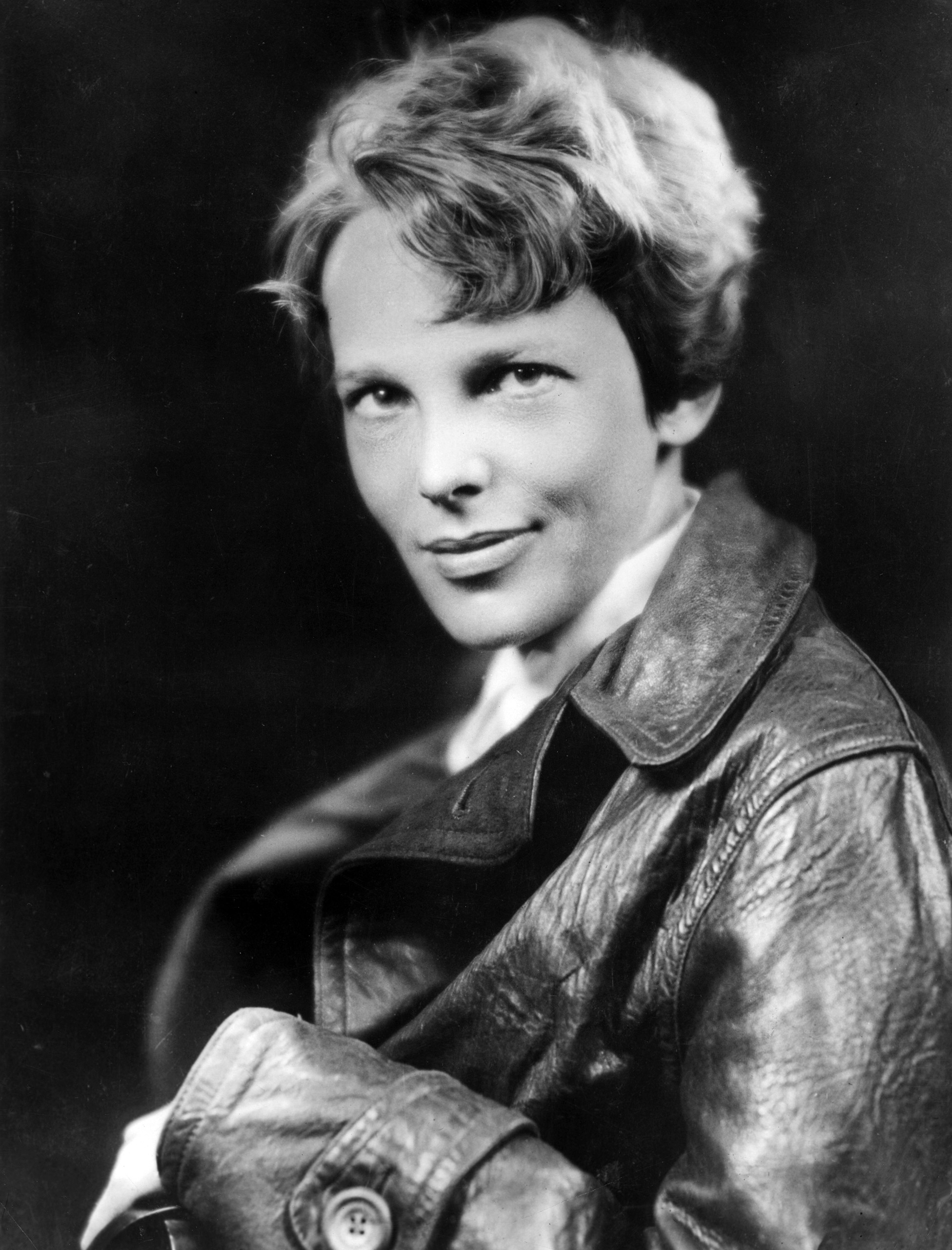 American aviator Amelia Earhart, the first woman to complete a solo transatlantic flight, wearing a leather jacket. Circa 1932.
